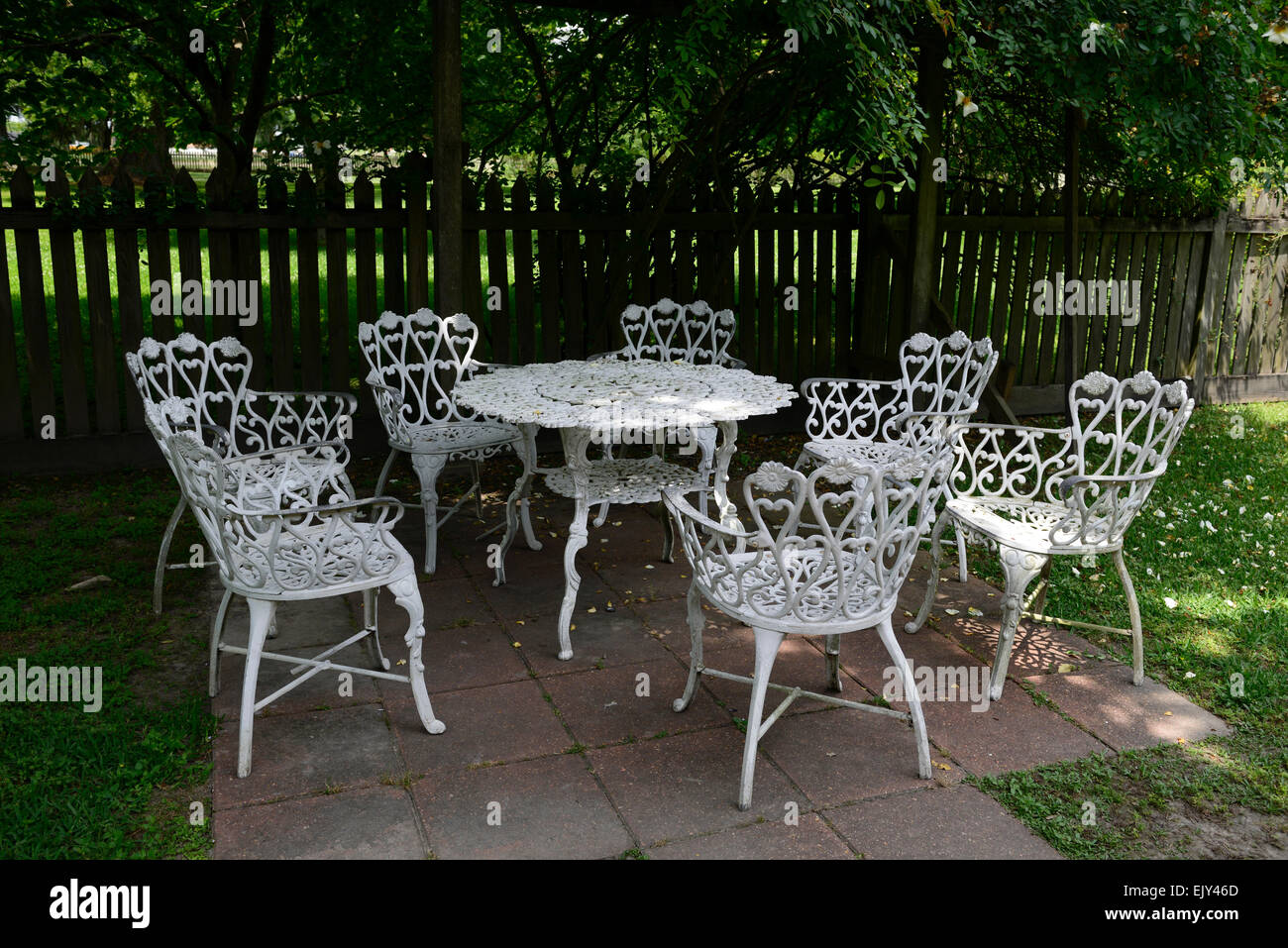 White wrought iron metal table chairs patio furniture shade shaded sheltered garden gardening rm floral