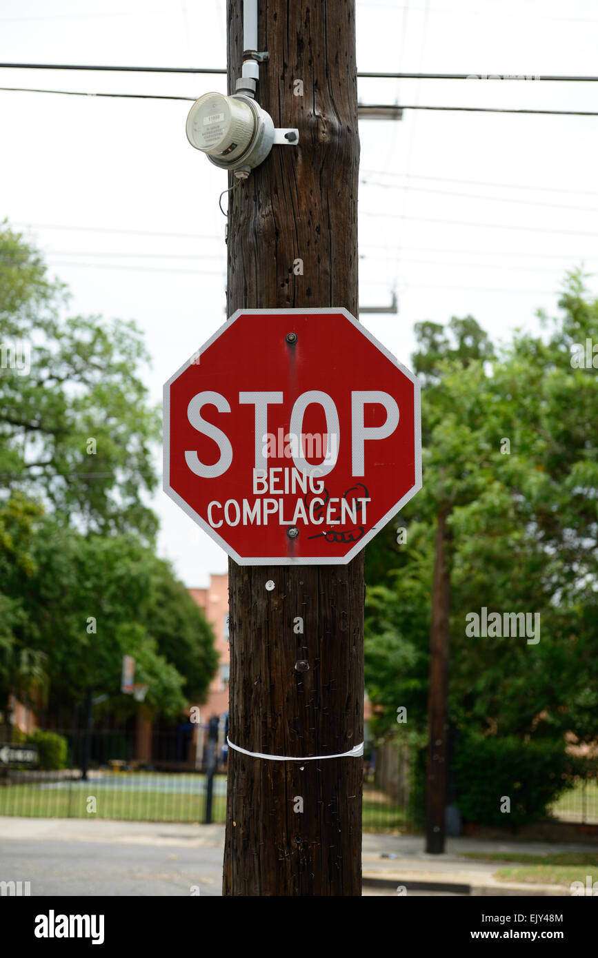 stop being complacent street road sign defaced deface graffiti humour humor message subliminal RM USA - Stock Image