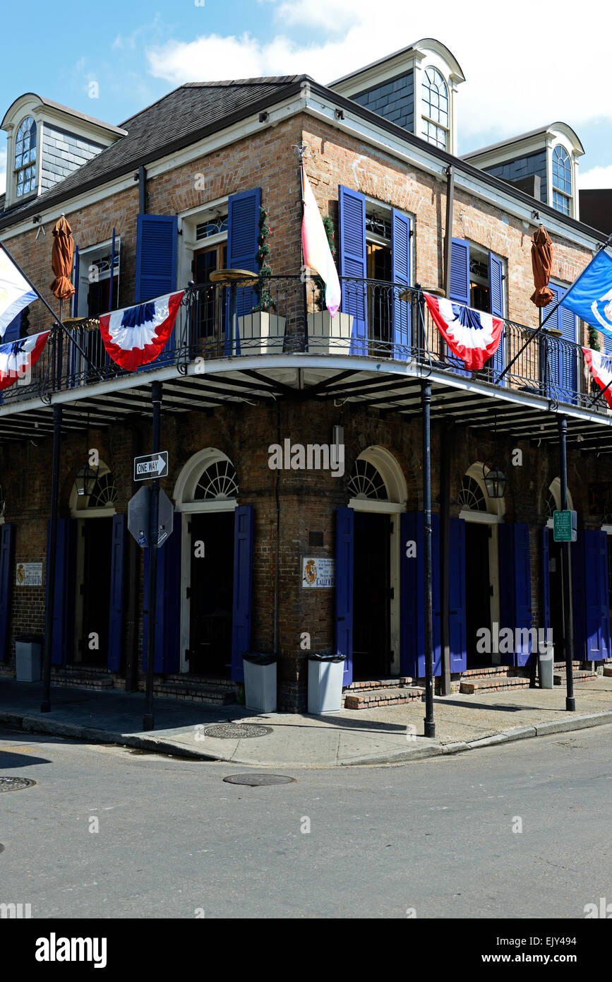 balcony on street corner navy blue shutters shuttering bourbon street french quarter new orleans prime view viewing - Stock Image