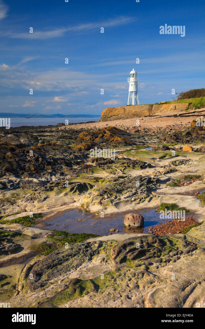 Black Nore Lighthouse near Portishead in North Somerset.  Captured at low tide from the rocky shoreline of the Severn - Stock Image