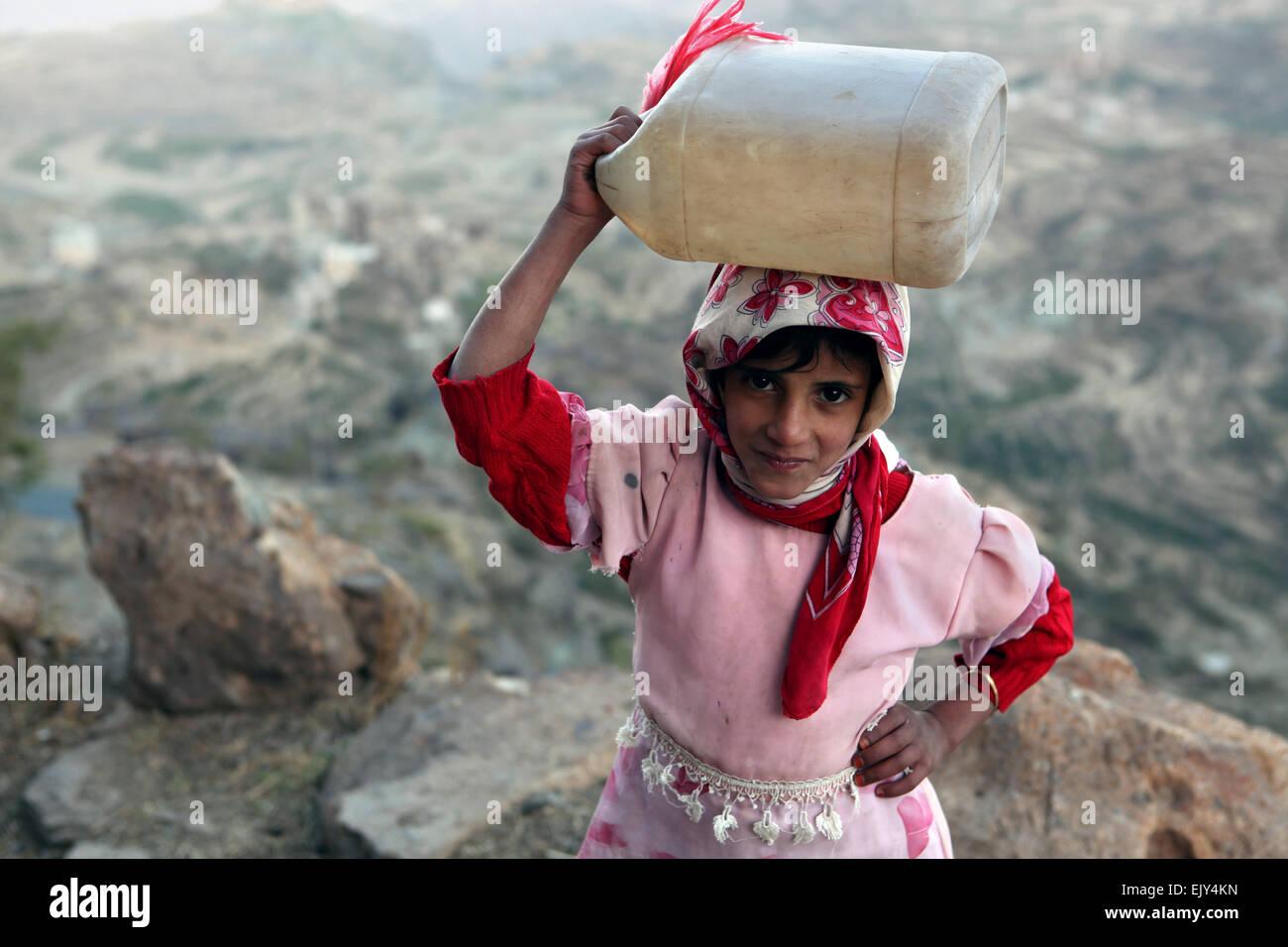 Girl walking home in rural Yemen. - Stock Image