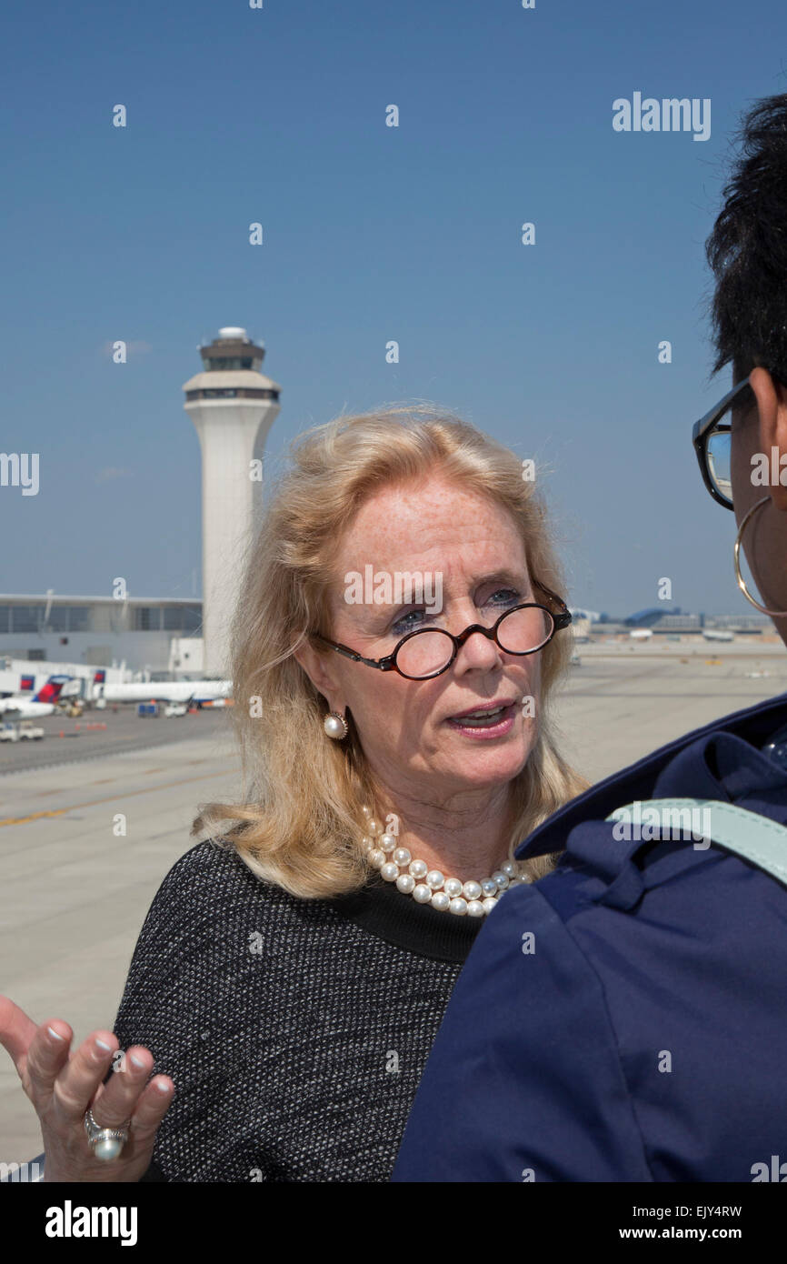 Romulus, Michigan - Congresswoman Debbie Dingell (D-Mich) speaks to an airport security screener at Detroit Metro - Stock Image