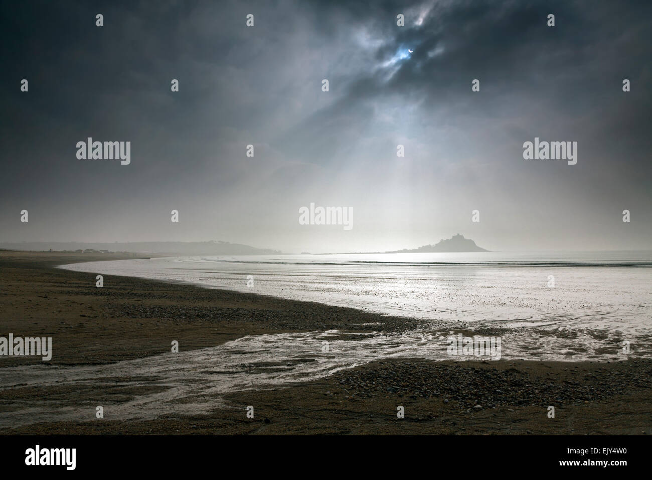 St Michael's Mount captured from Long Rock Beach during the partial eclipse in March 2015. - Stock Image