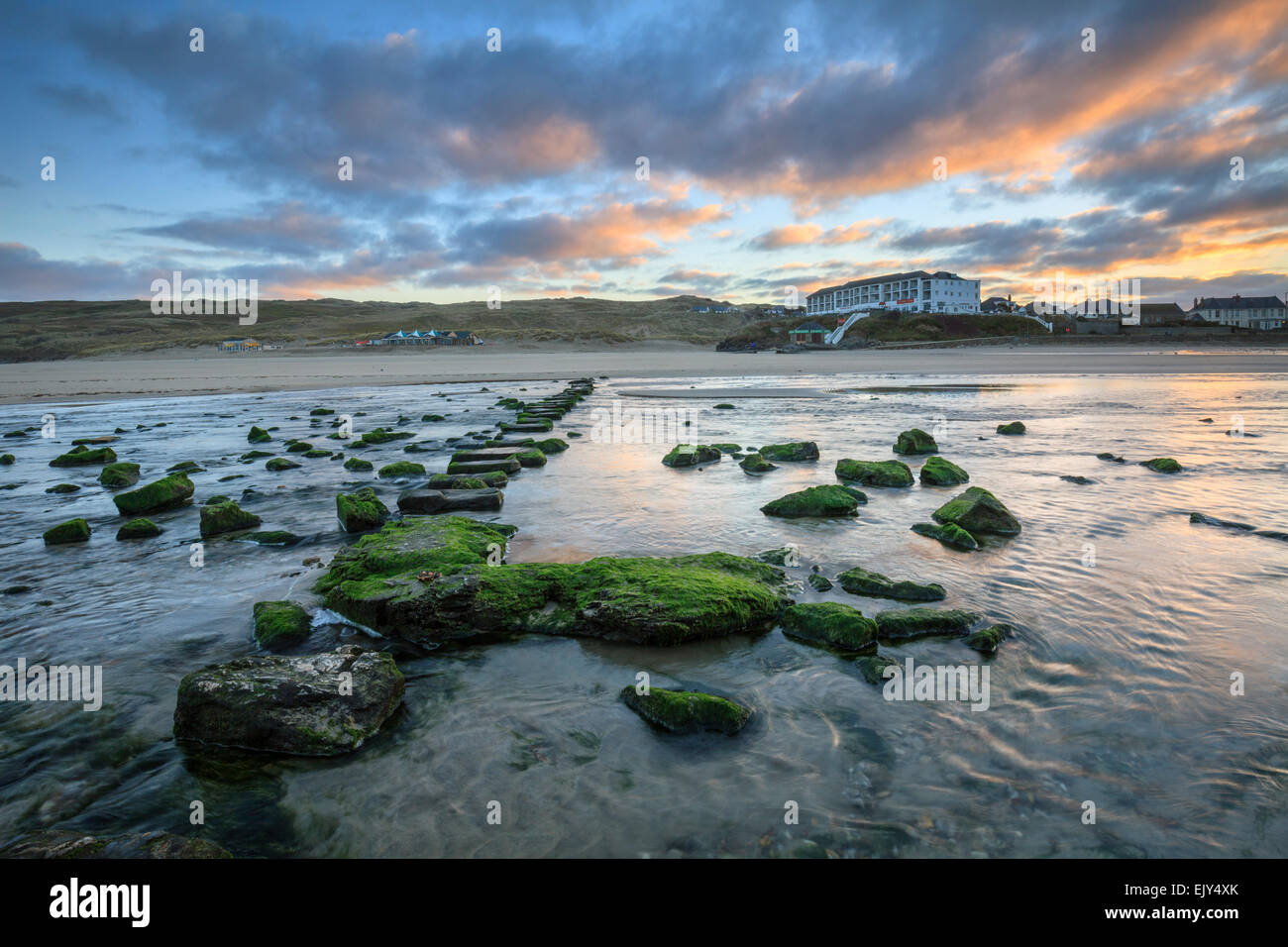 The stepping stones on Perranporth Beach captured at sunrise. - Stock Image