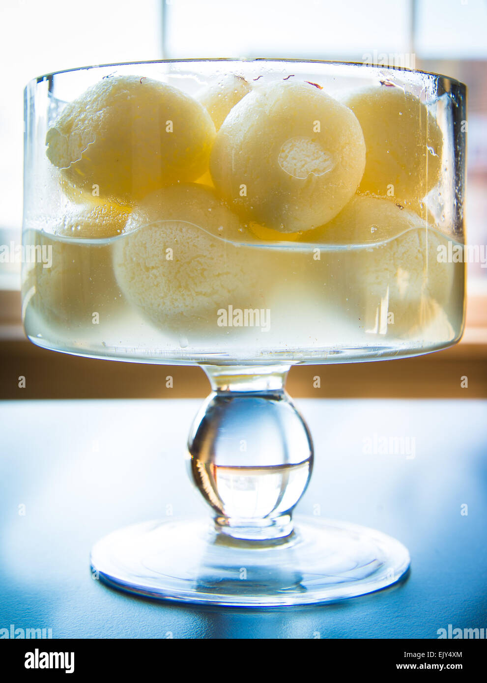 Indian sweet Rasgulla is a syrupy dessert popular in the Indian subcontinent, and is made out of Indian cottage - Stock Image