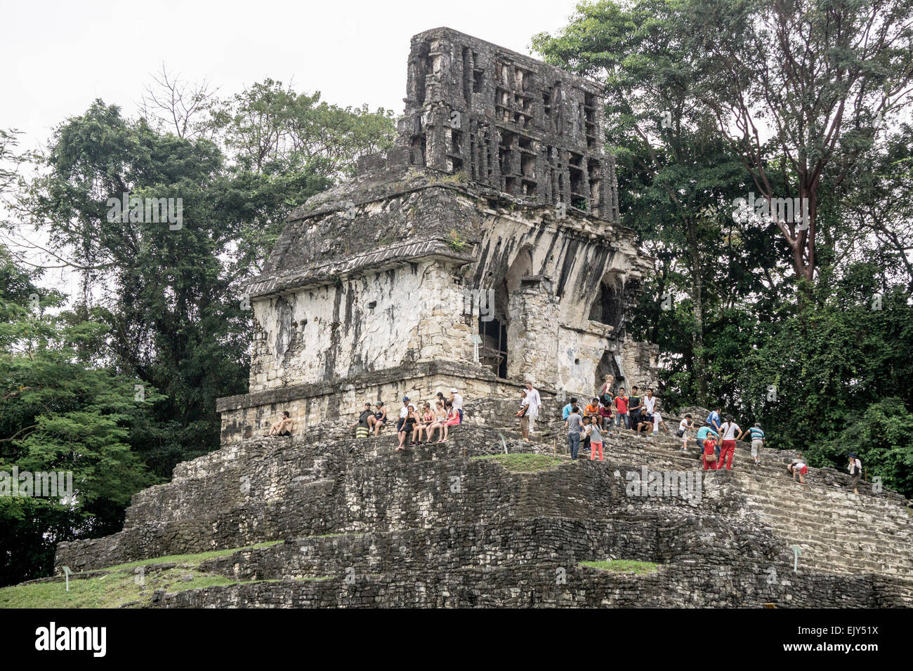 tourists enjoy the view & rest after the arduous climb to the Temple of the Cross with its well preserved roof - Stock Image