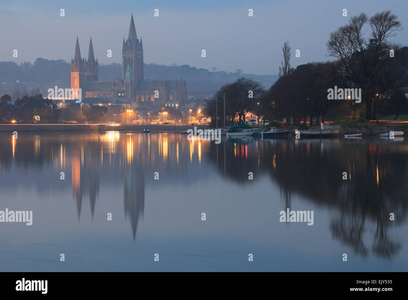 Truro Cathedral reflected in Truro River. - Stock Image
