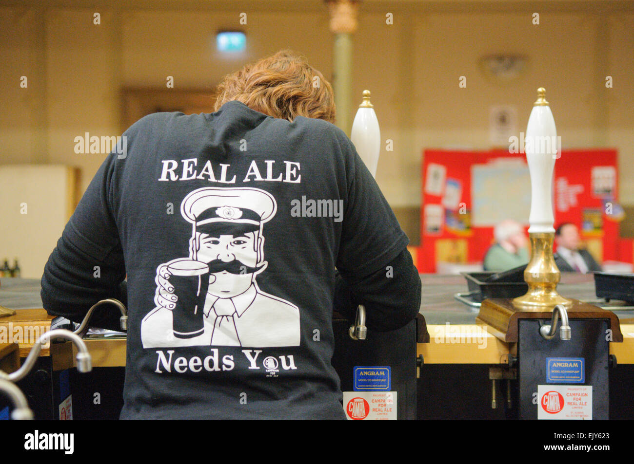 A bartender at a CAMRA Real Ale festival wears a tee shirt saying 'Real Ale Needs You' - Stock Image