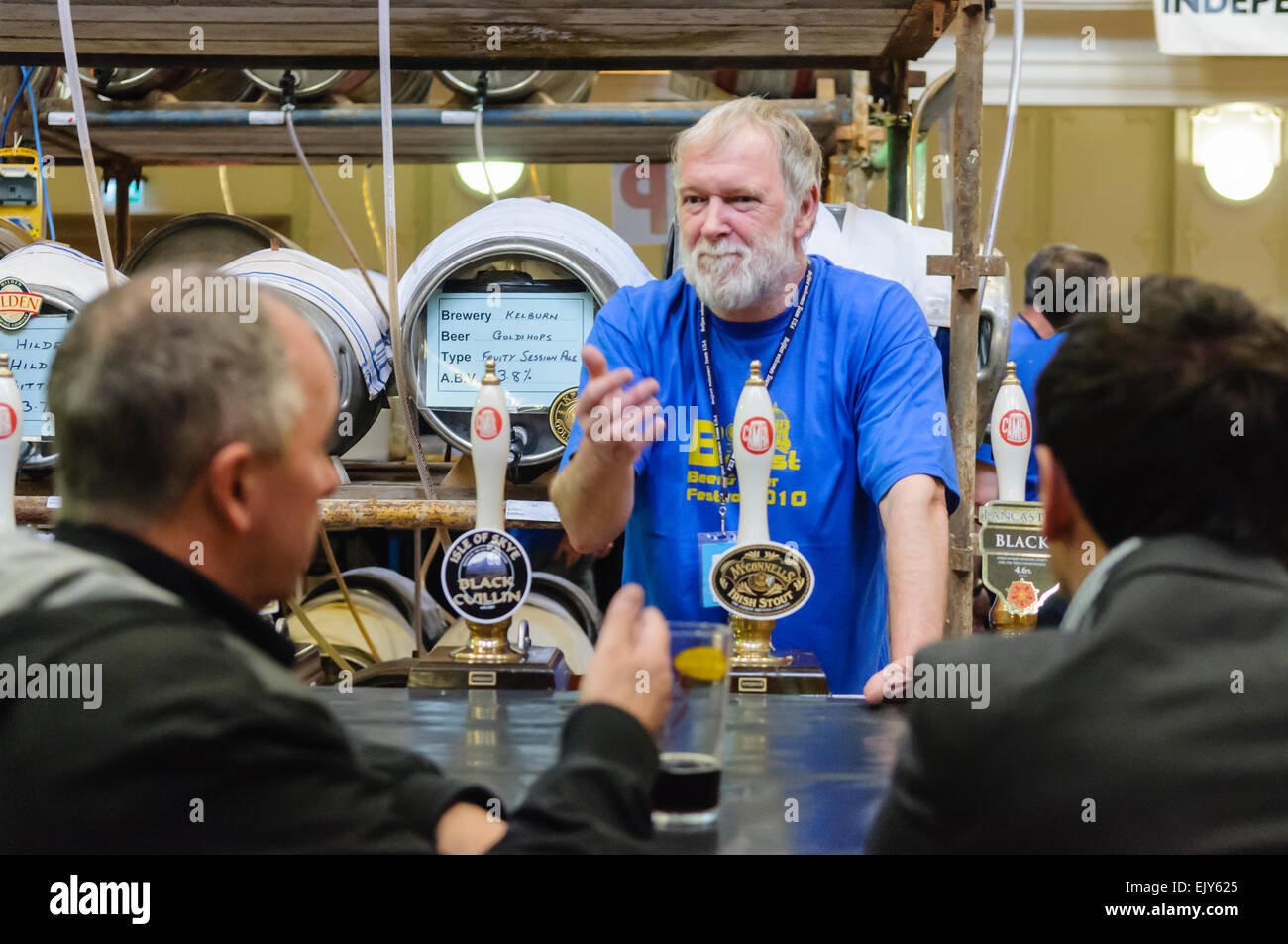 A barman serves customers at a CAMRA real ale festival. Stock Photo