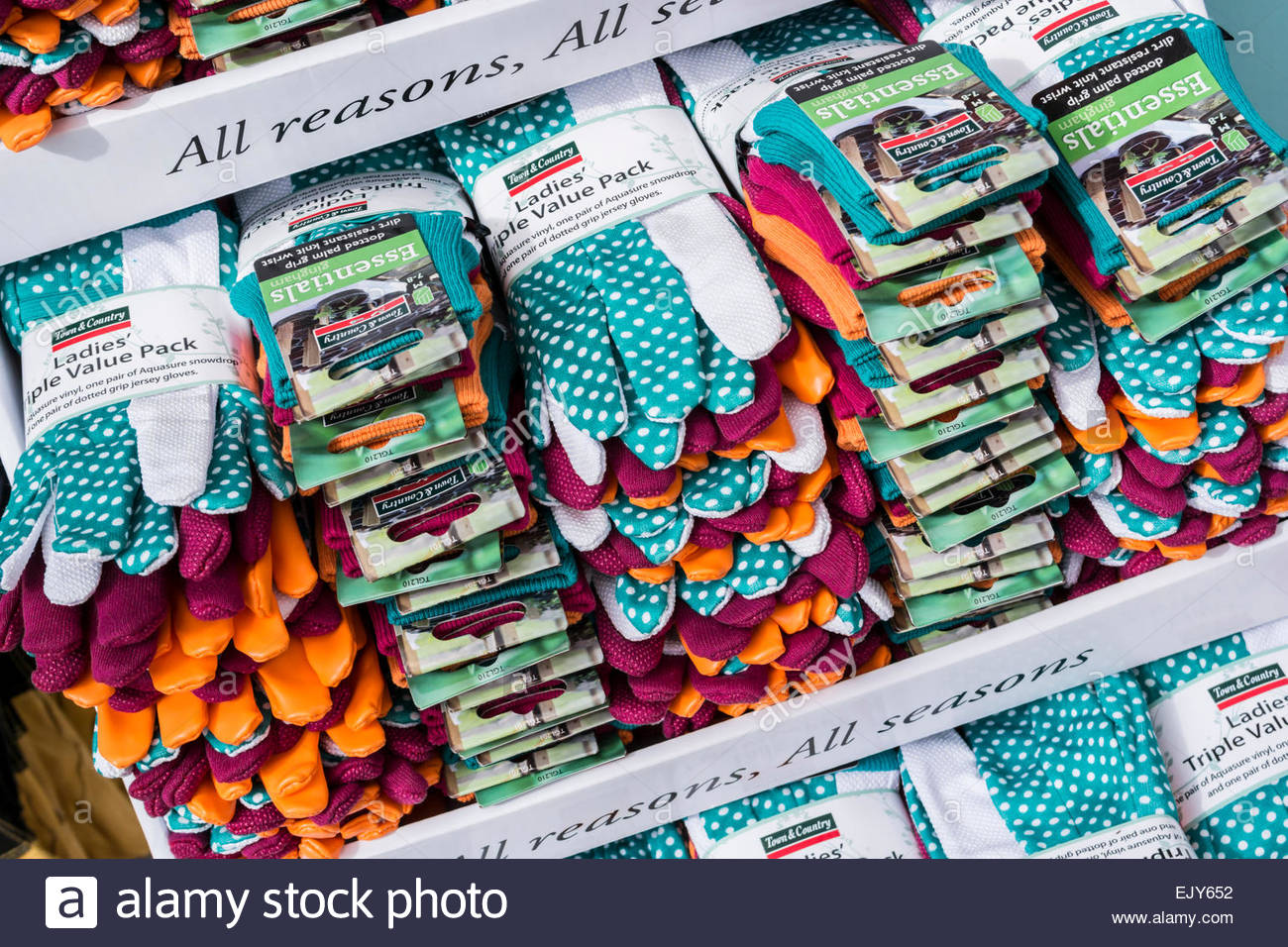 Display of gardening gloves on sale at a garden centre - Stock Image