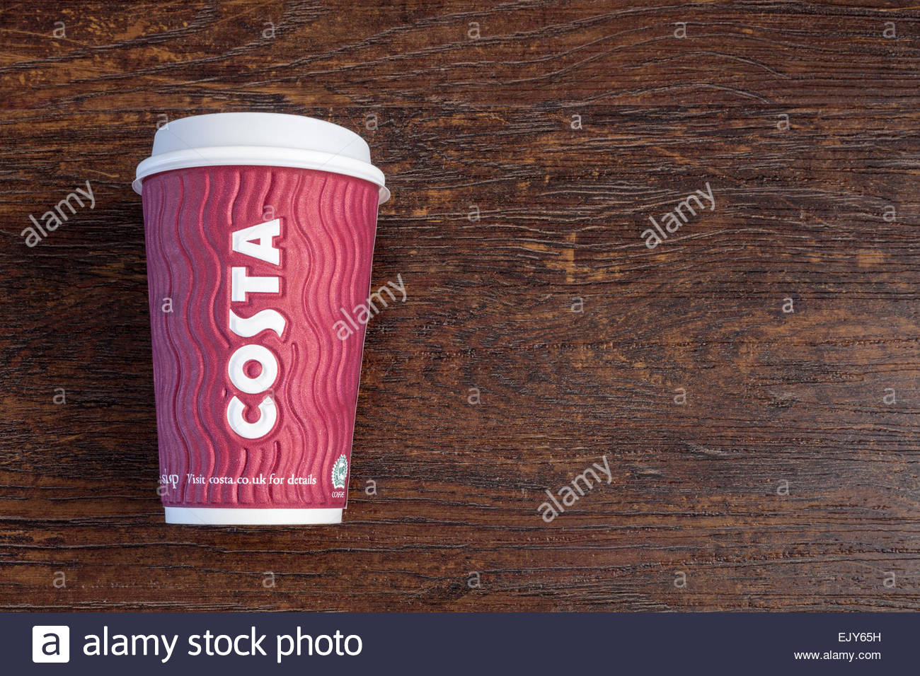 Costa Coffee disposable paper cup with plastic lid - Stock Image