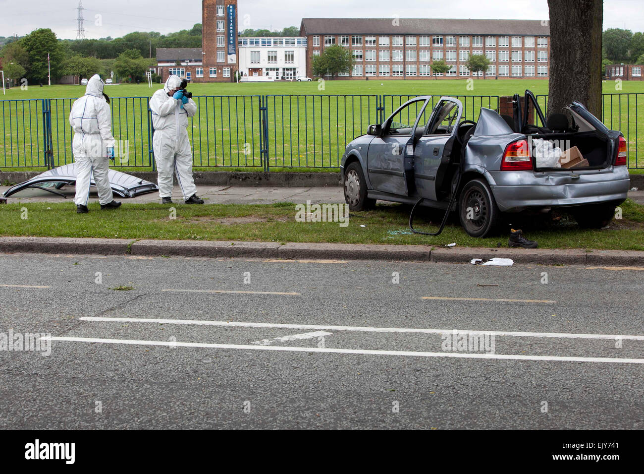 Scene of a crash after a car chase on Radcliffe Road Bury . - Stock Image