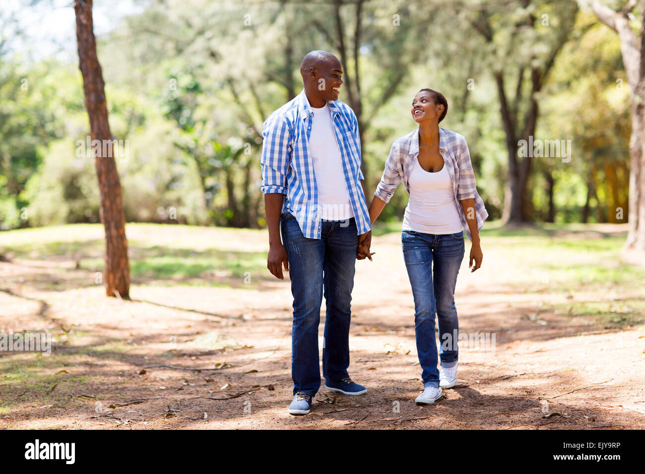 happy African couple enjoying a walk at the park Stock Photo