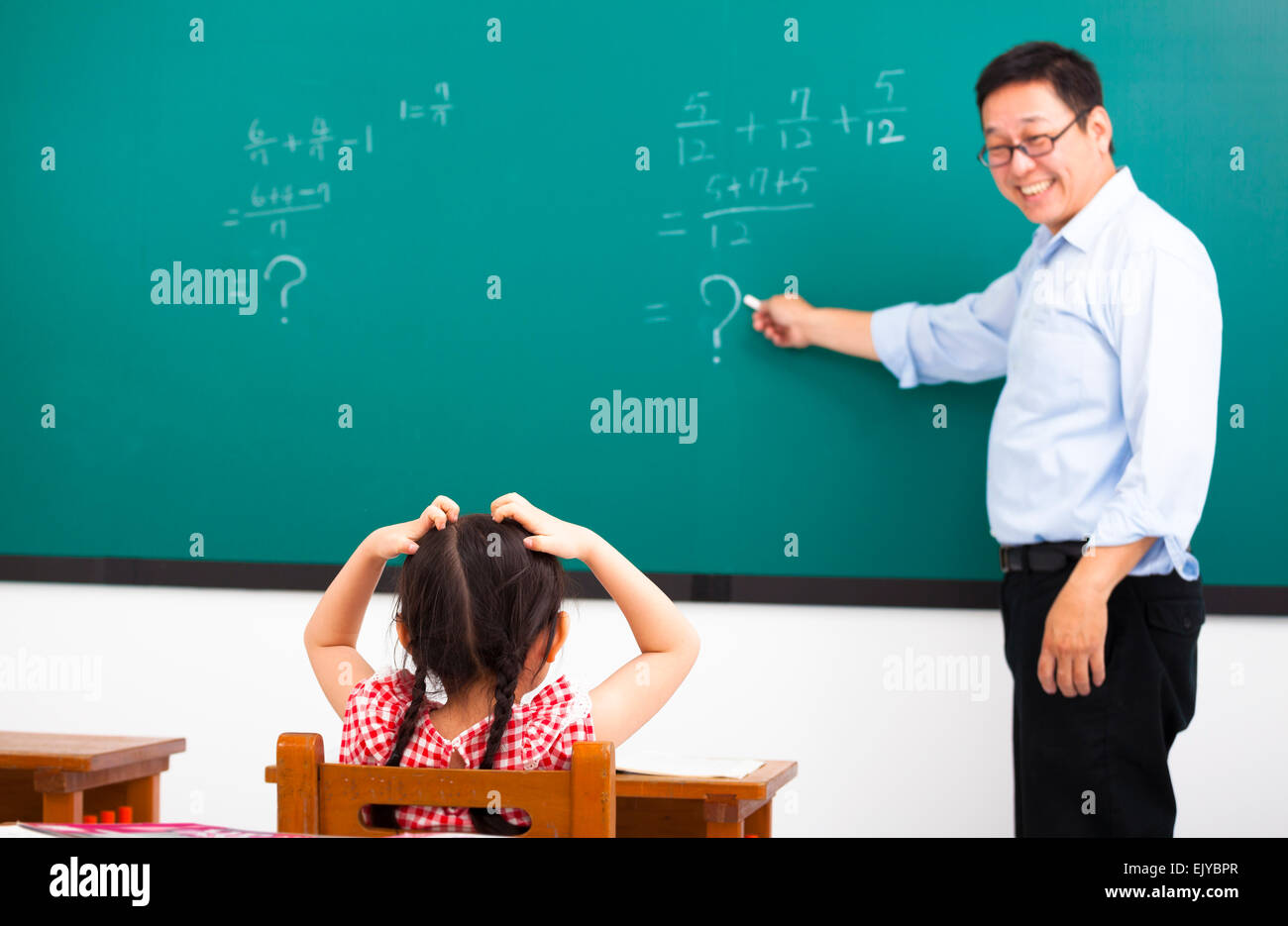 teacher asking question with children in classroom Stock ...
