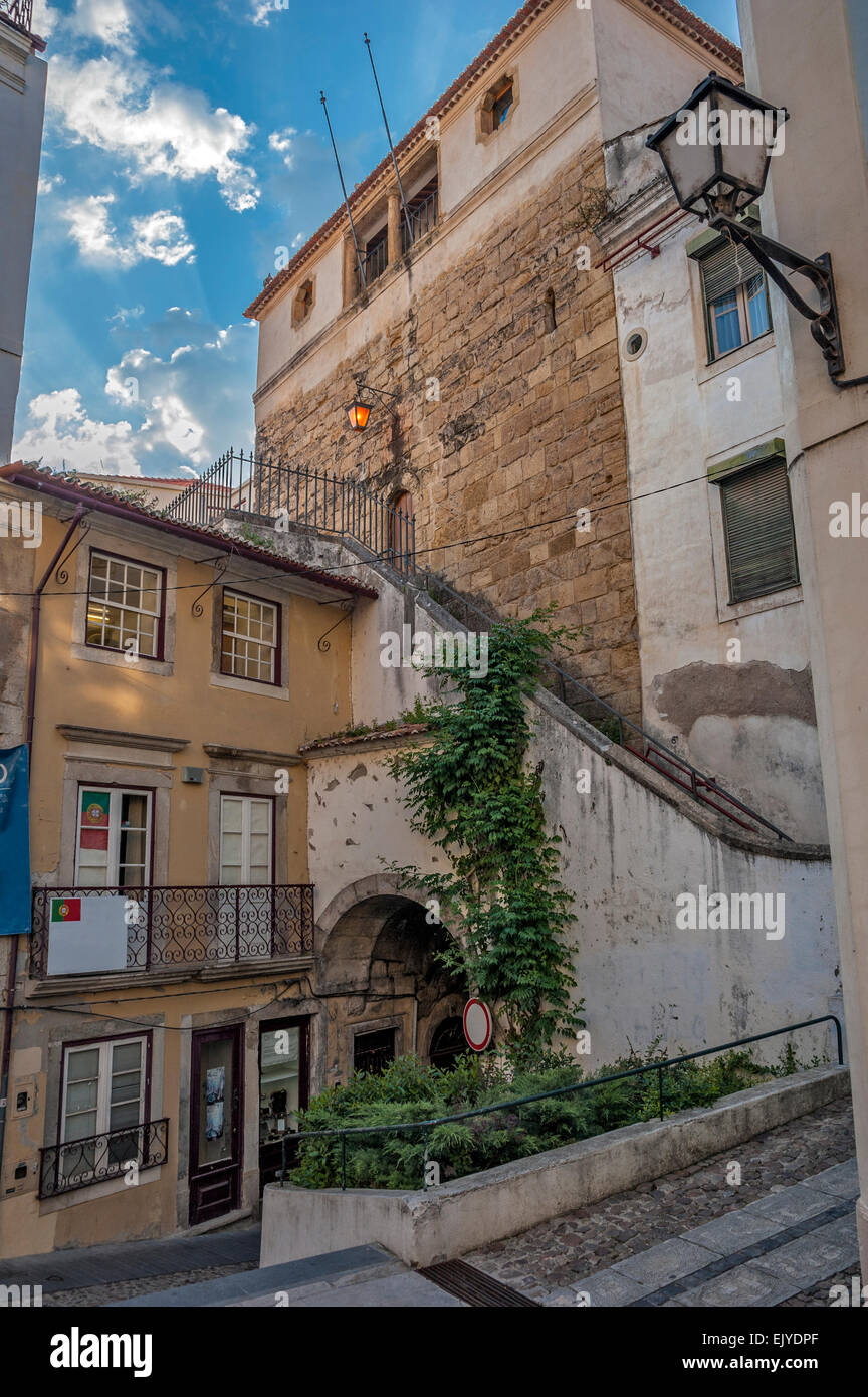 Portugal, Coimbra . Courtyards and streets of the old city in the evening. Stone sidewalks and streets . - Stock Image