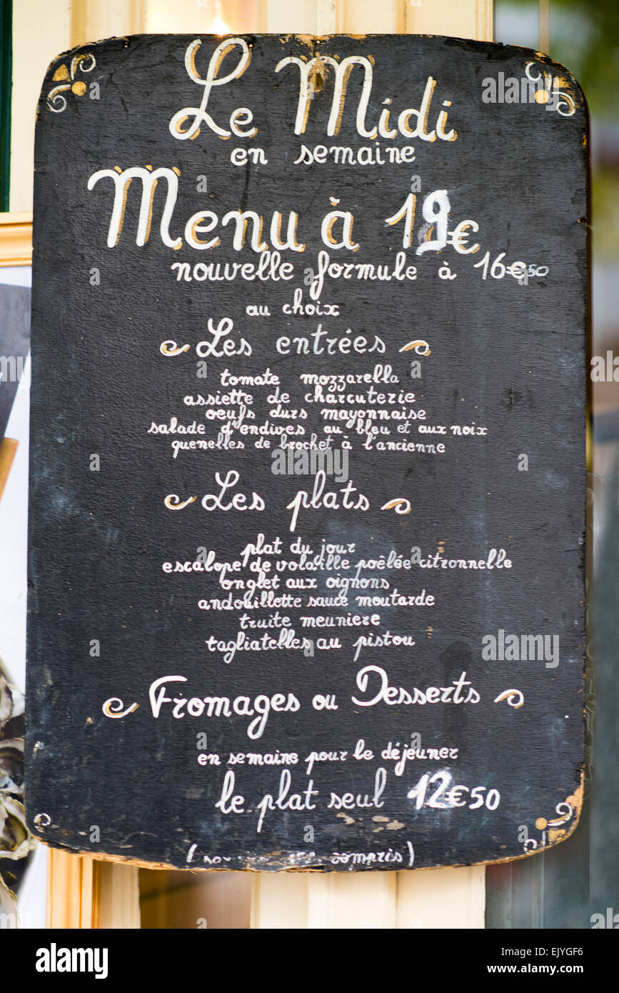 chalkboard menu sign at outdoor cafe in paris france stock photo
