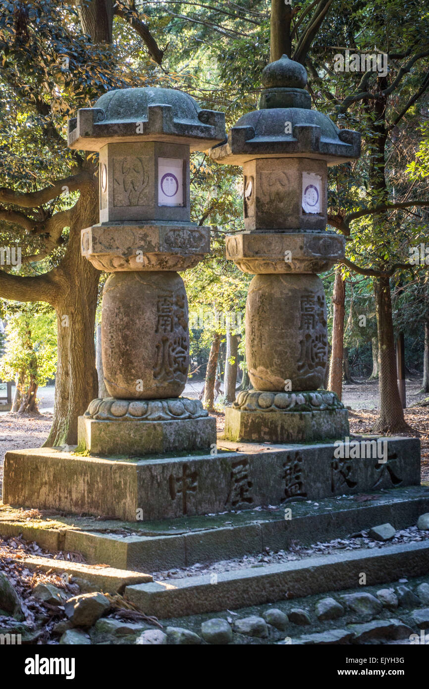 Two ancient Japanese stone lanterns in the forest near Kasuga Grand Shrine, Nara, Japan - Stock Image