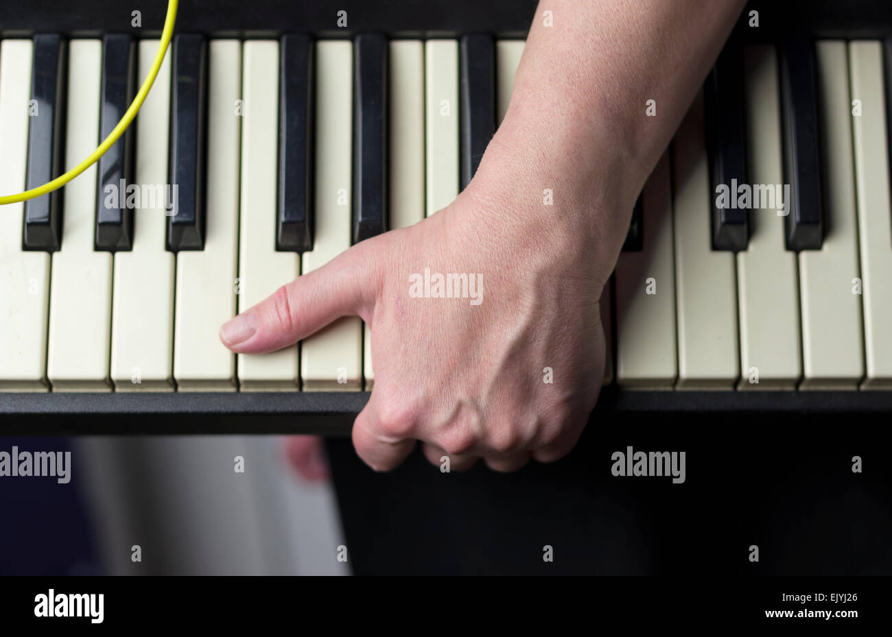 Carrying a synthesizer keyboard - Stock Image