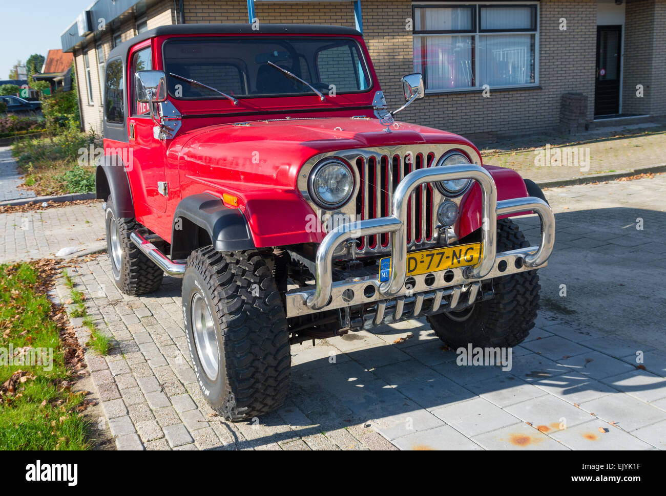 red jeep wrangler car with chrome bull bar. The production of the Wrangler began in 1987 and was succeeded in 1997 - Stock Image