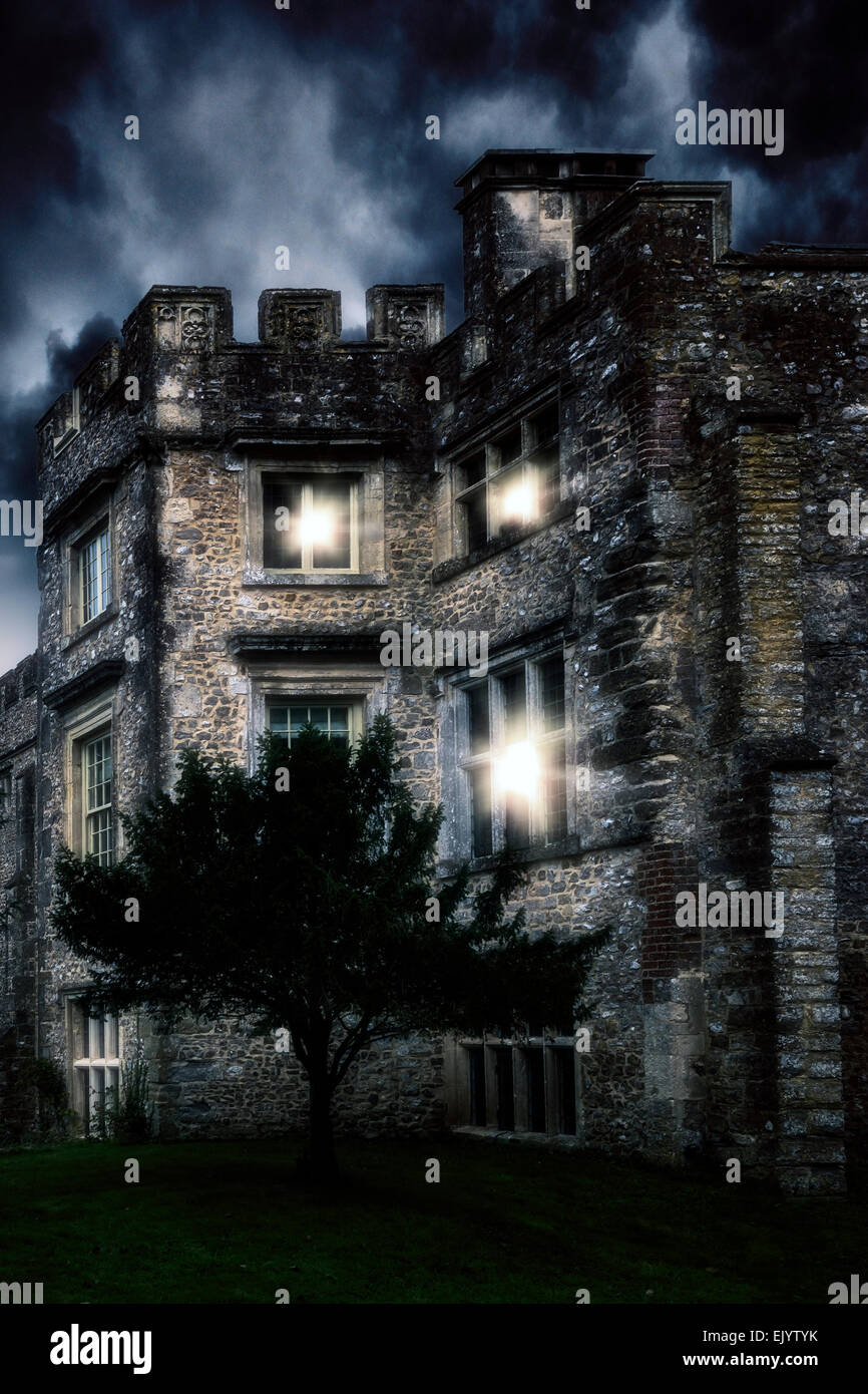 a spooky castle in the night - Stock Image