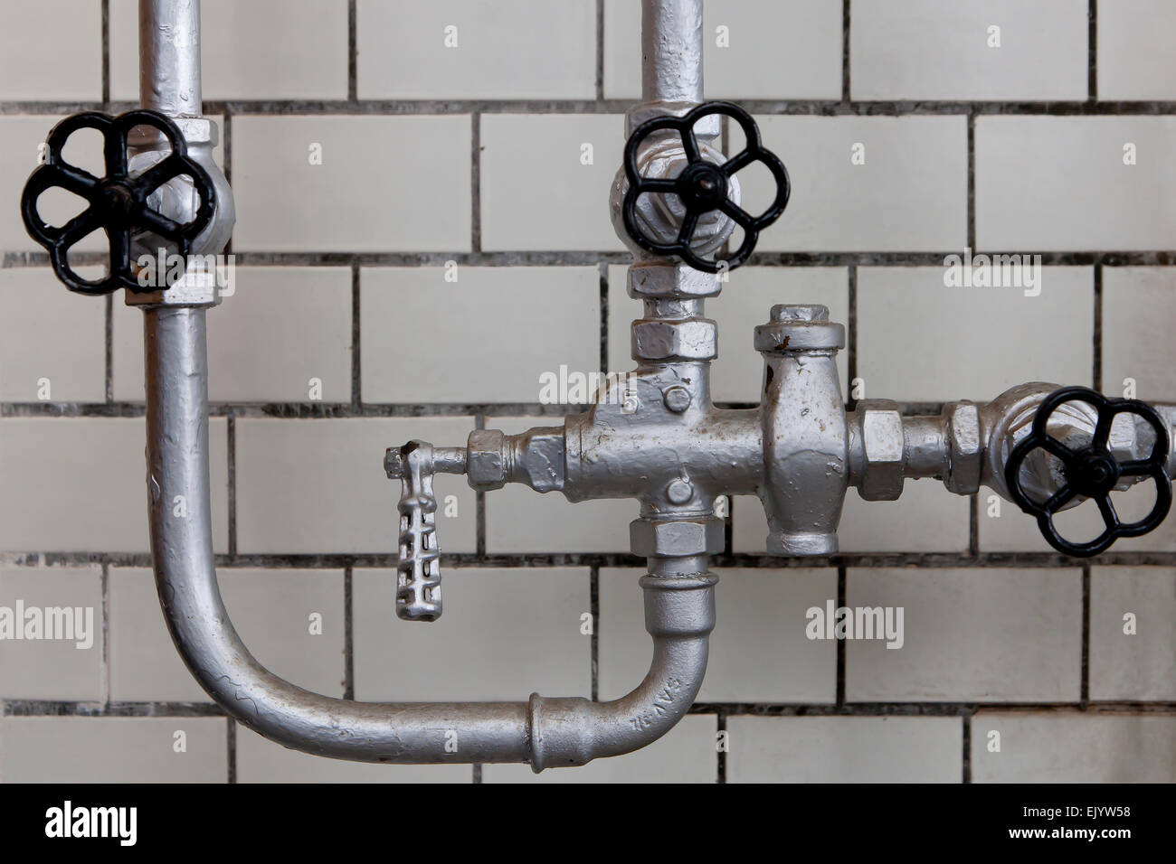 Old pipes and valves - Stock Image