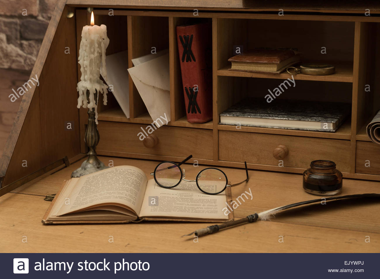 Antique desk with his pen and old books - Antique Desk With His Pen And Old Books Stock Photo: 80518218 - Alamy