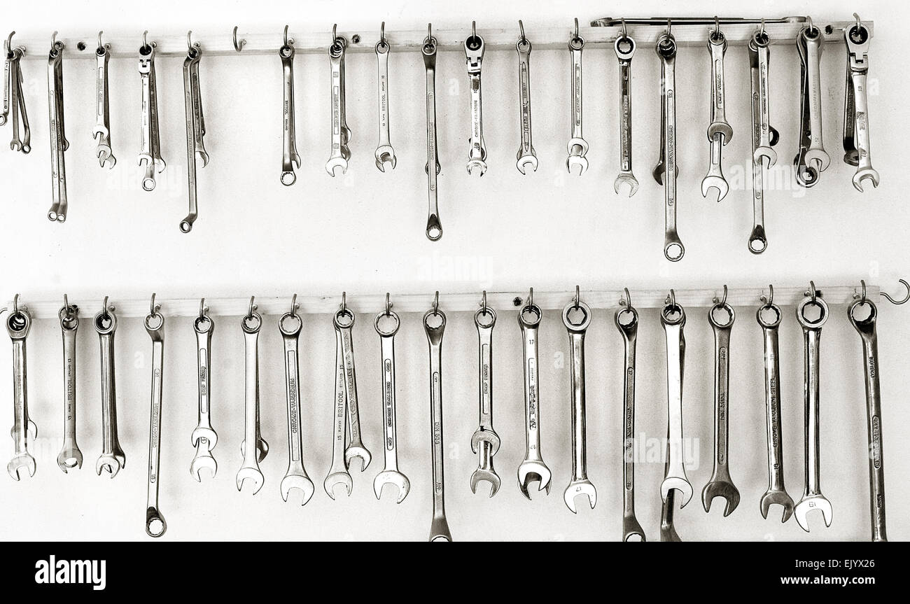 A regiment of Spanners hanging in the garage. - Stock Image