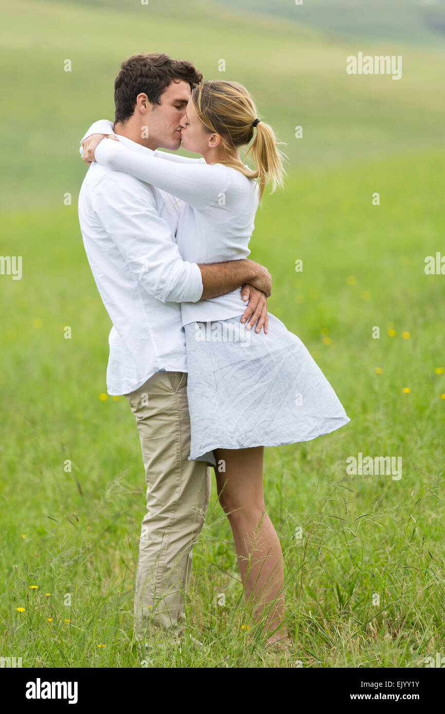 Beautiful Young Couple Kissing On Green Field Stock Photo 80519207