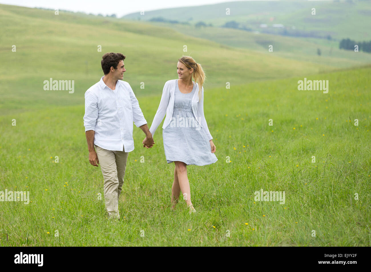 lovely couple walking on countryside - Stock Image
