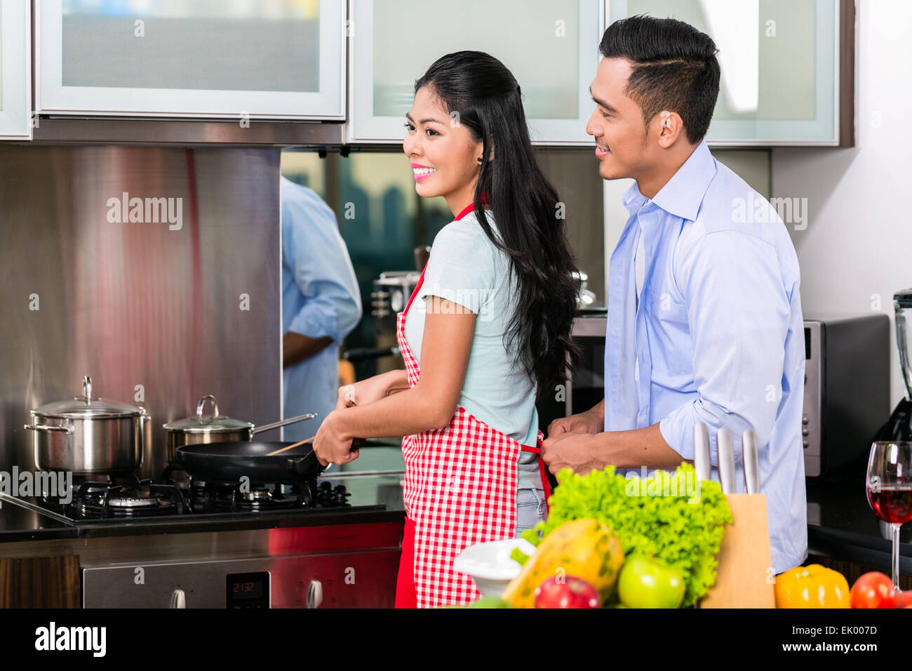 Couple in domestic Kitchen cooking food Stock Photo