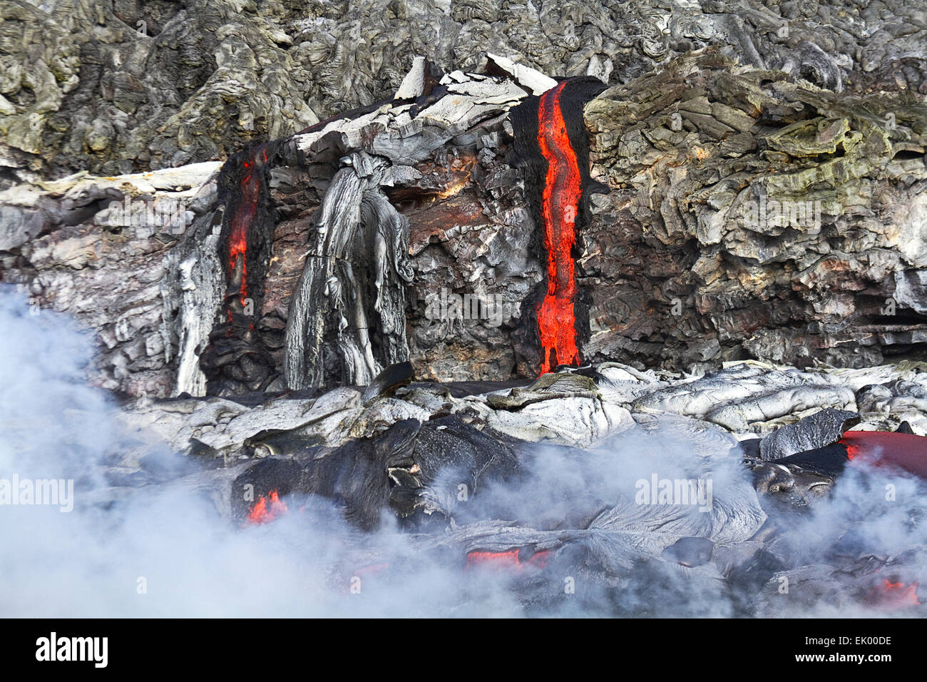 Lava from Kilauea pouring out of volcanic vent and flowing into the pacific ocean, Big Island, Hawaii, USA - Stock Image