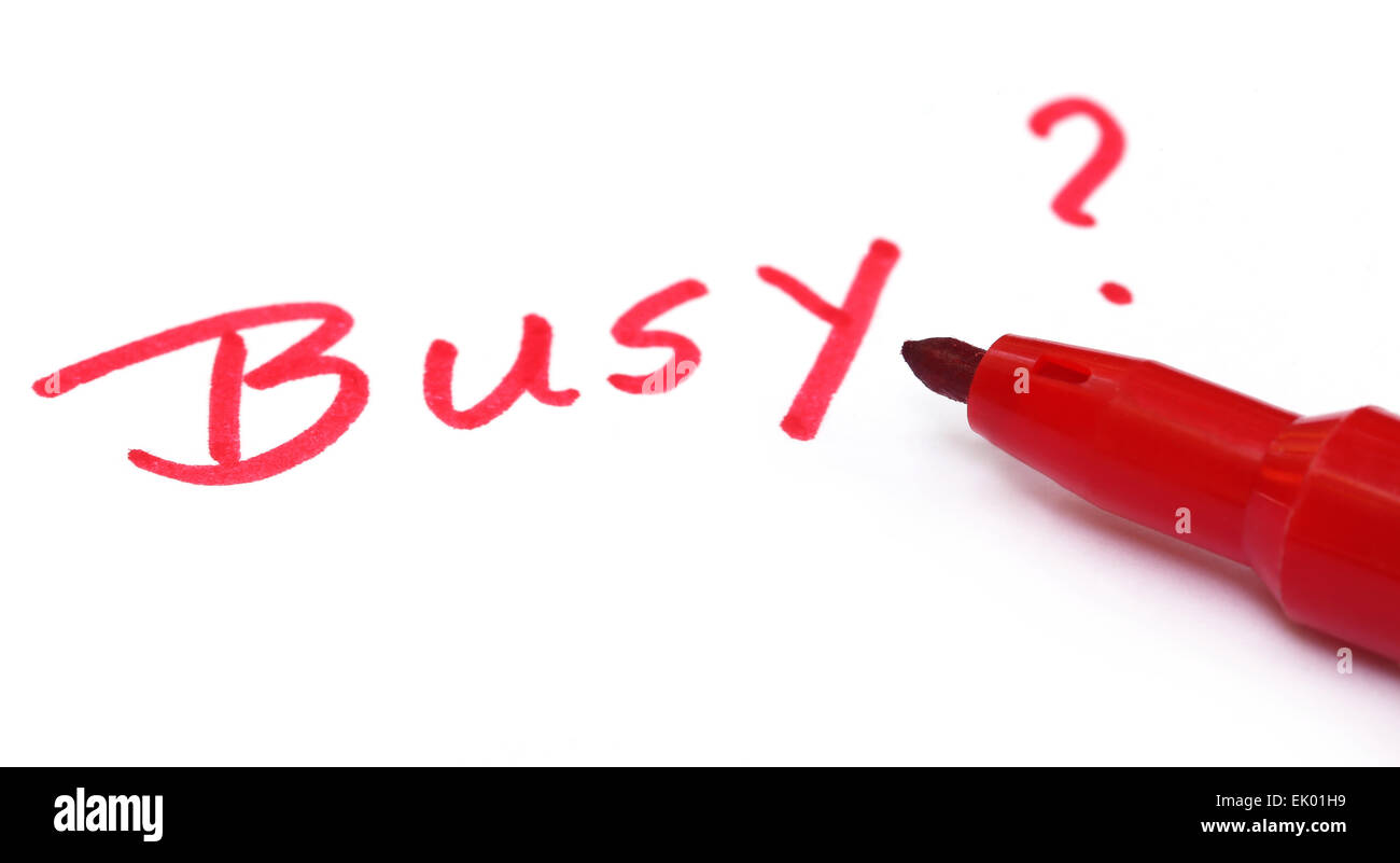 Busy written in wihite paper with red pen - Stock Image