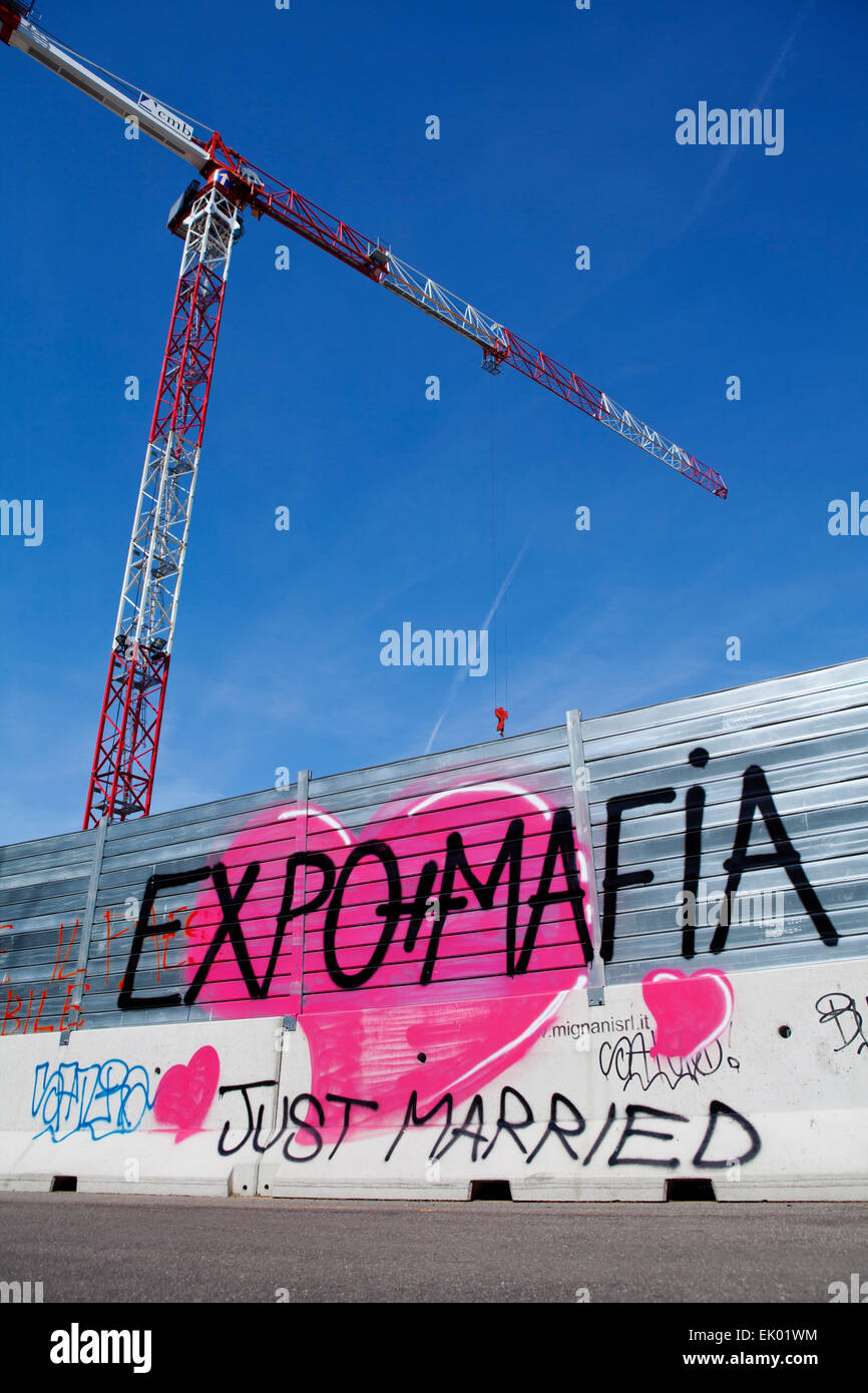 Graffiti painted on a wall about the connection between the expo Milan 2015 with the mafia. - Stock Image