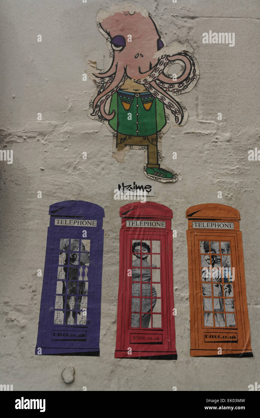 Portrait white wall with Nzime octopus head man and three D7606 phone box paste-ups, Spear Street, Stevenson Square, - Stock Image