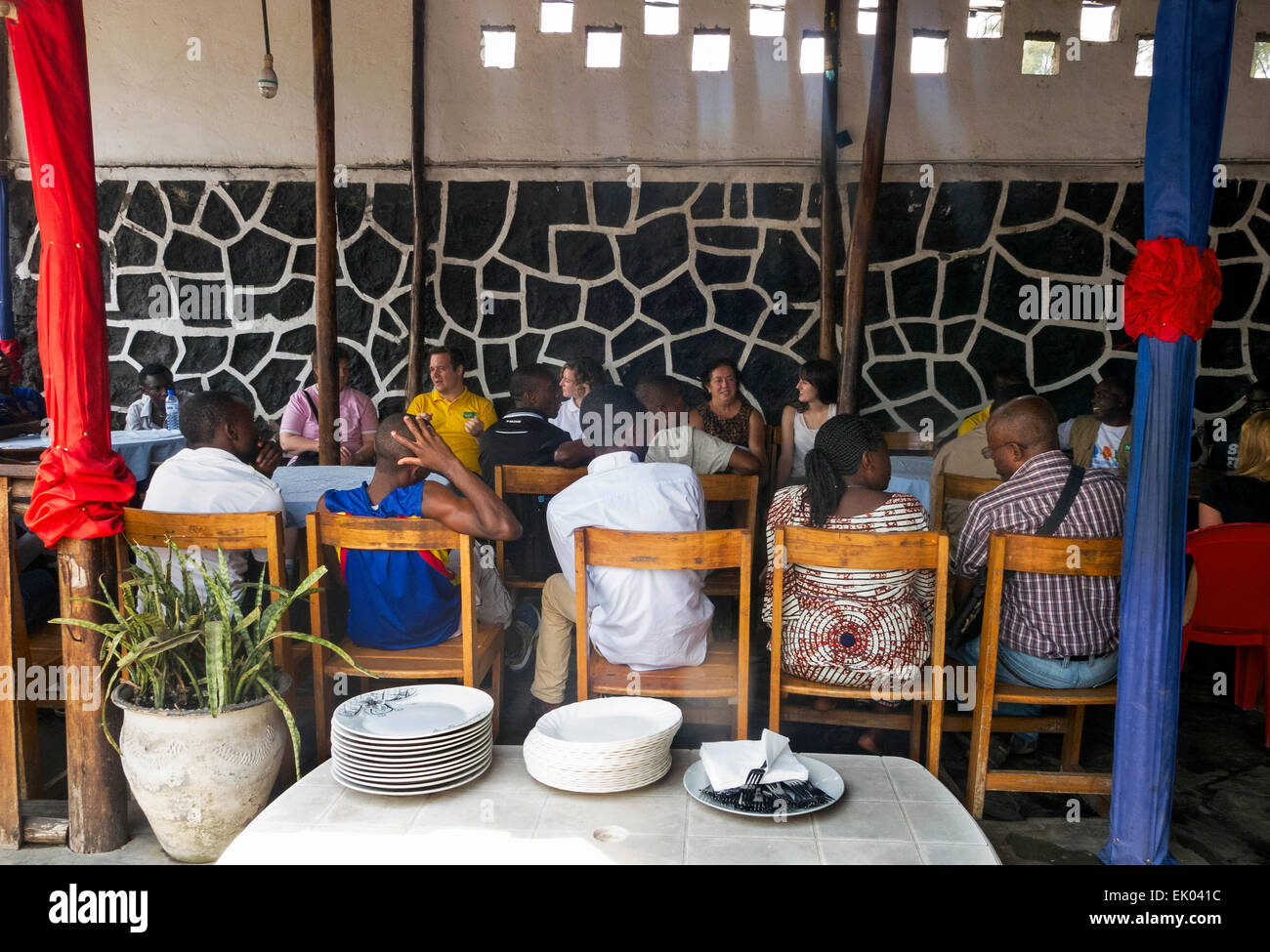 People sitting in a restaurant, Goma, Democratic Republic of Congo ( DRC ), Africa - Stock Image