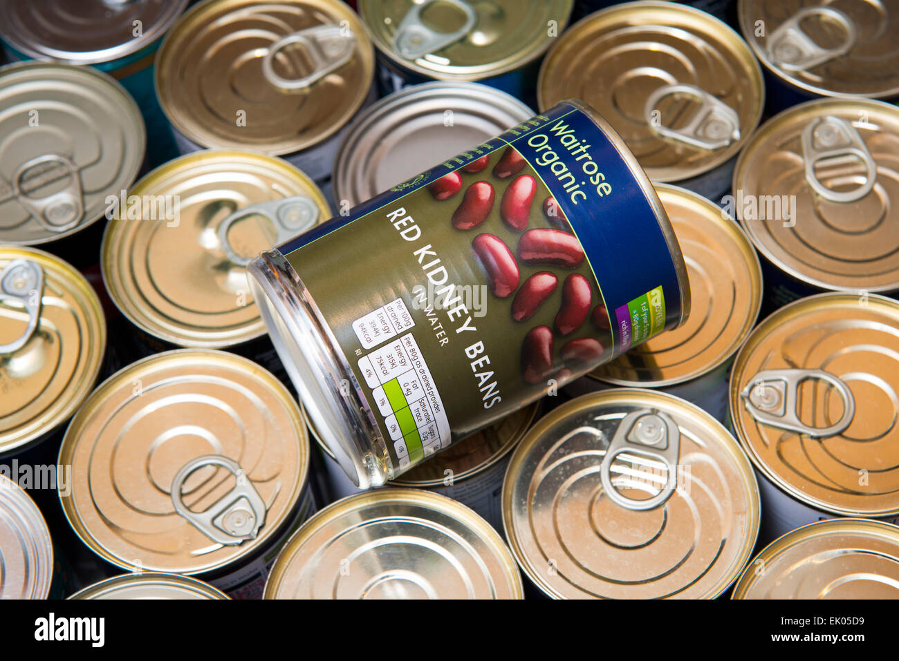 A can of red kidney beans in a drawer of canned food. - Stock Image