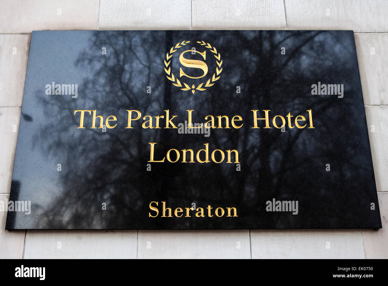 LONDON, UK - APRIL 1ST 2015: The plaque next to the entrance of The Park Lane Hotel located on Piccadilly in London - Stock Image