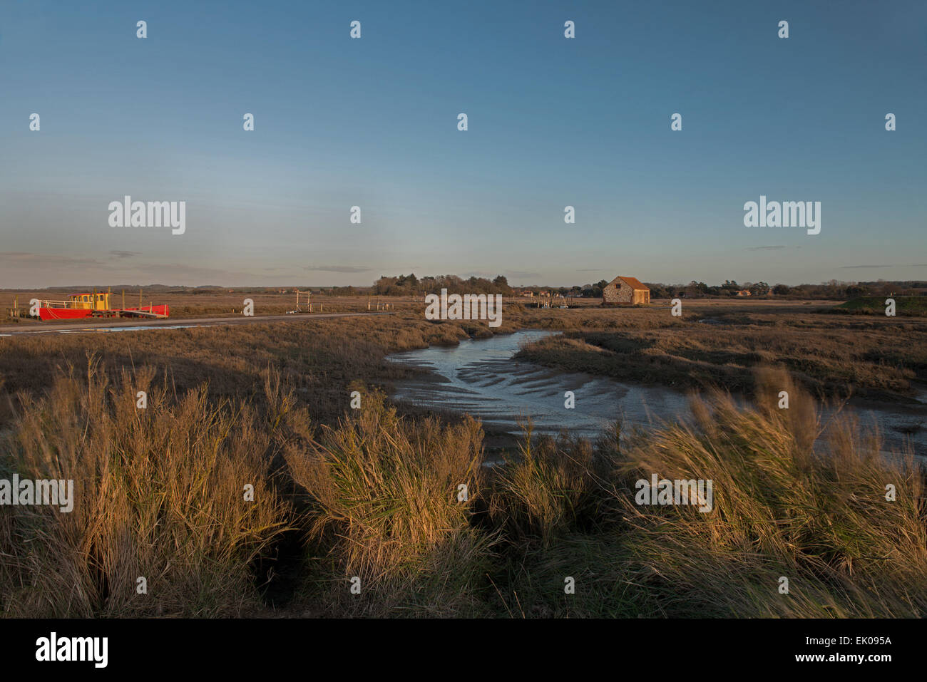 Evening light over the  muddy creek at low tide Holme Dunes Nature Reserve, Thornham Norfolk England. UK, GB - Stock Image