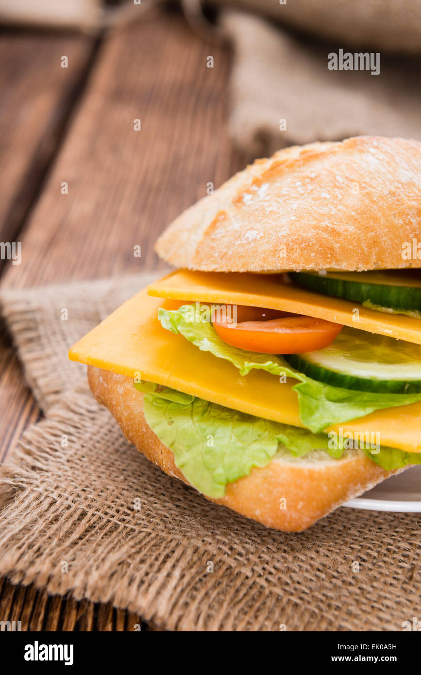 Cheddar Cheese Sandwich (detailed close-up shot) on wooden background - Stock Image