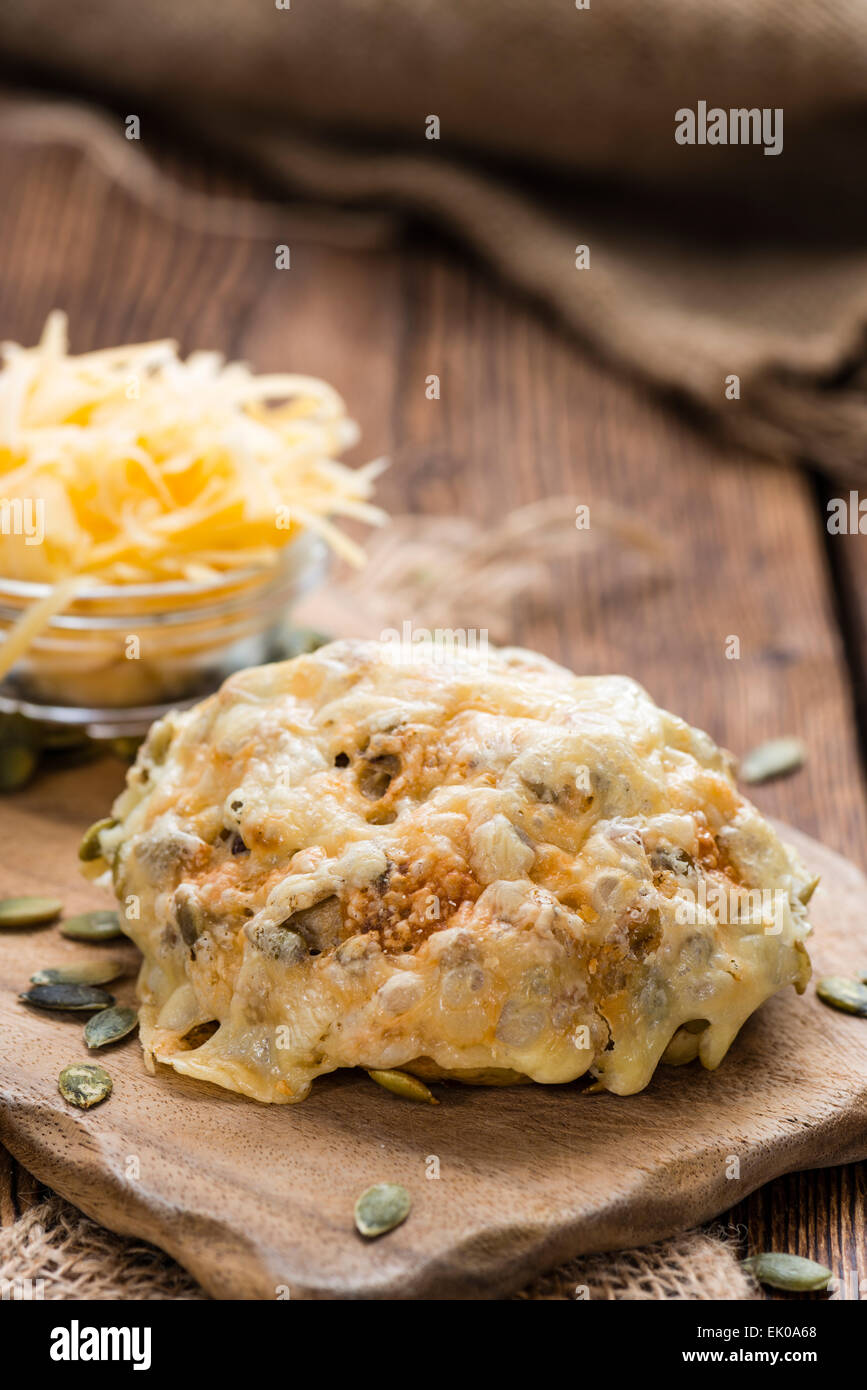 Homemade Buns gratinated with Cheese (close-up shot) - Stock Image