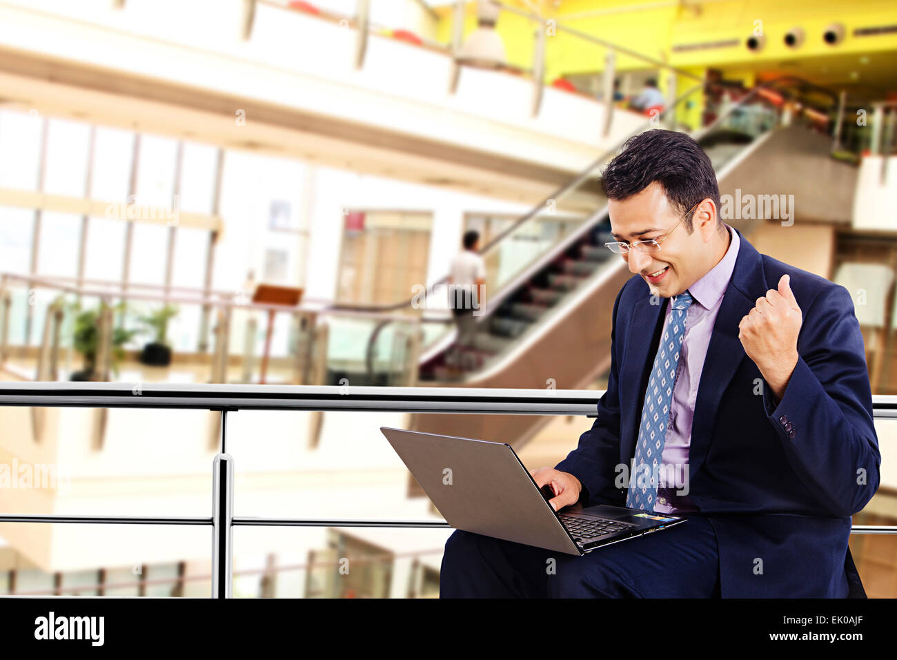 1 indian Businessman mall Laptop working - Stock Image