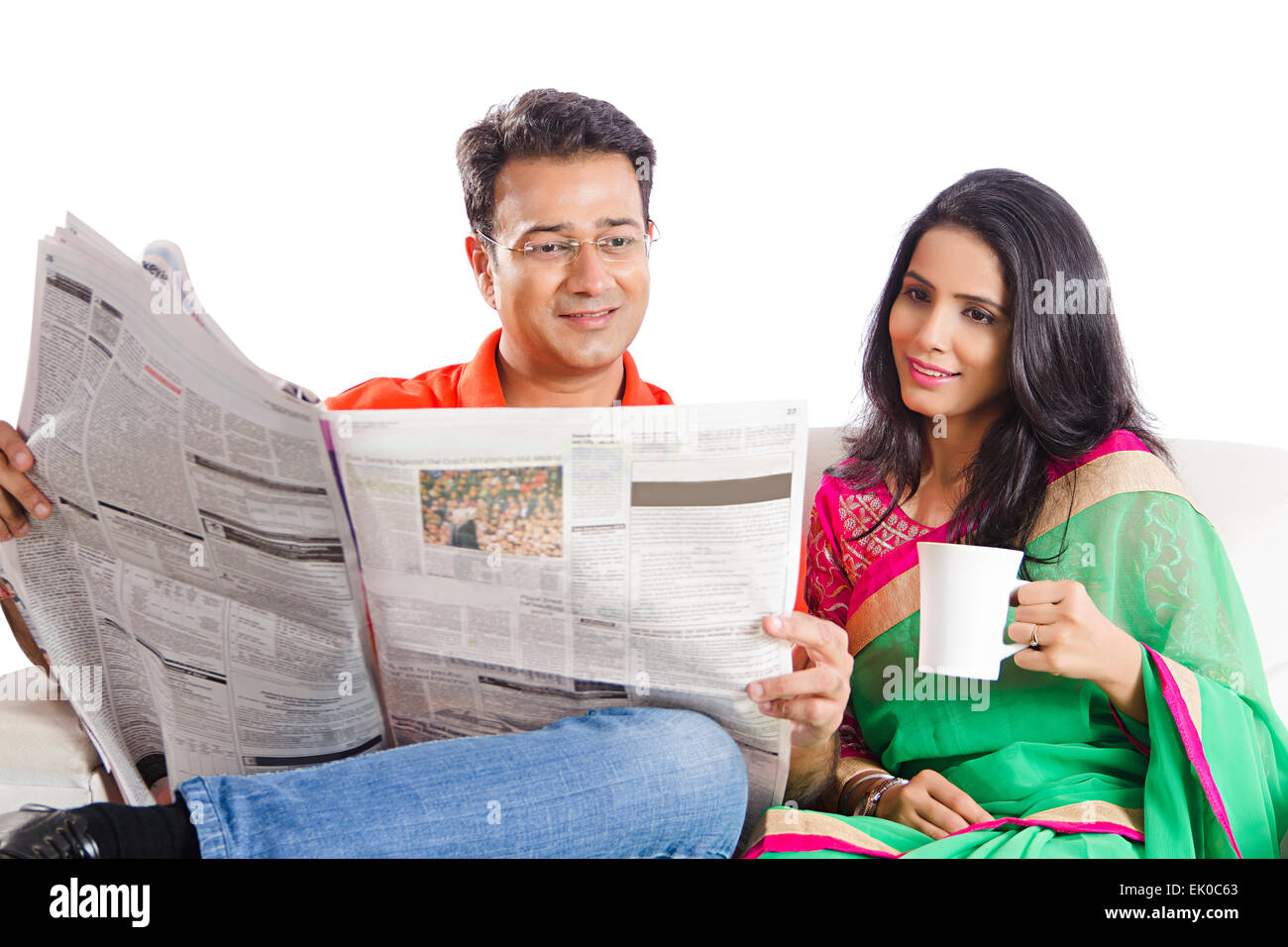 2 indian married couples home newspaper reading stock photo