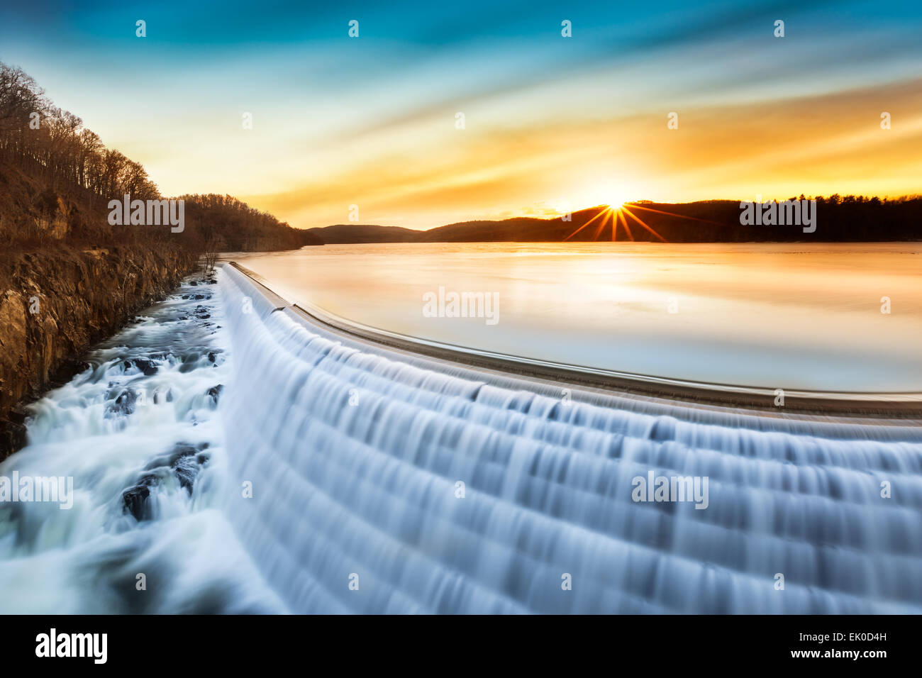 Sunrise over Croton Dam, NY and its stepped spillway waterfall - Stock Image