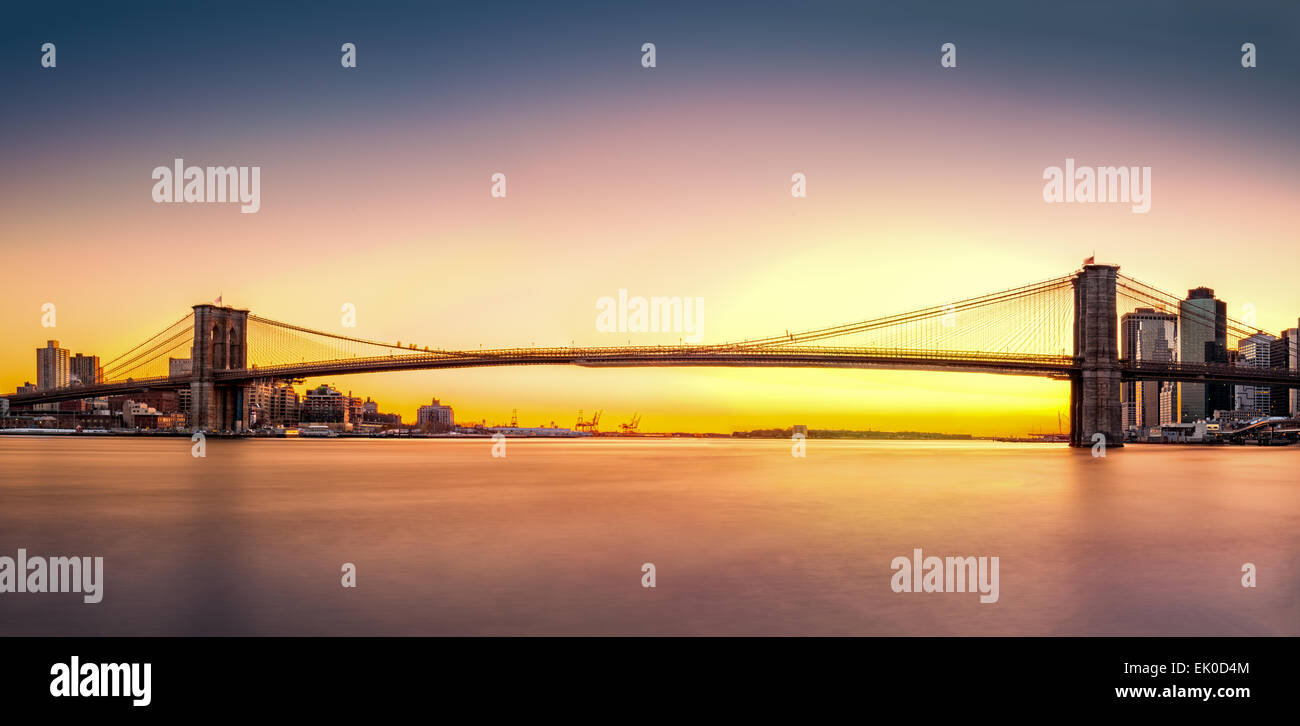 Brooklyn Bridge panorama at sunset - Stock Image