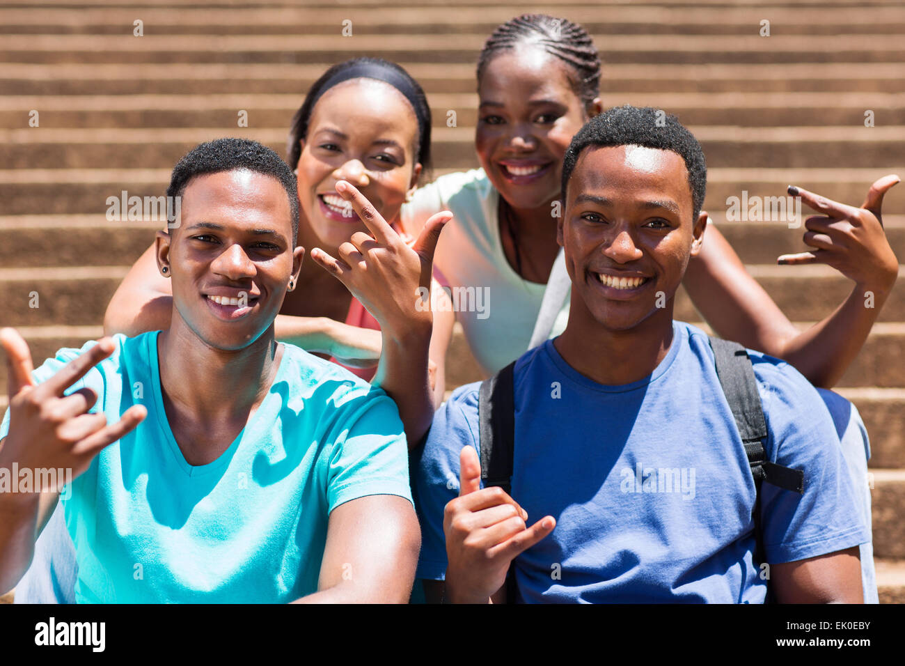 Group Of Happy African American College Students Hand Signs