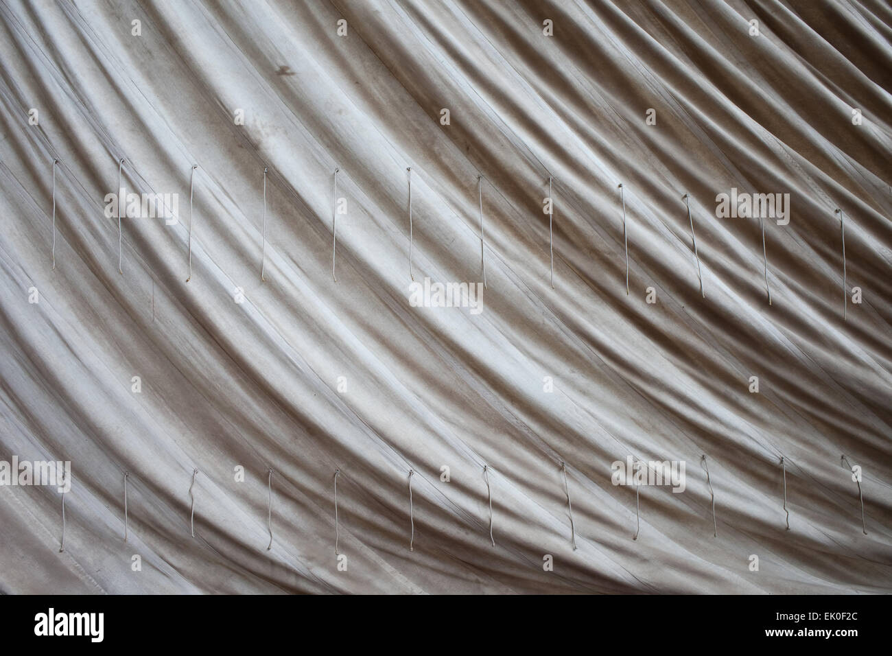 Old sailcloth background from a historic sailing boat. - Stock Image