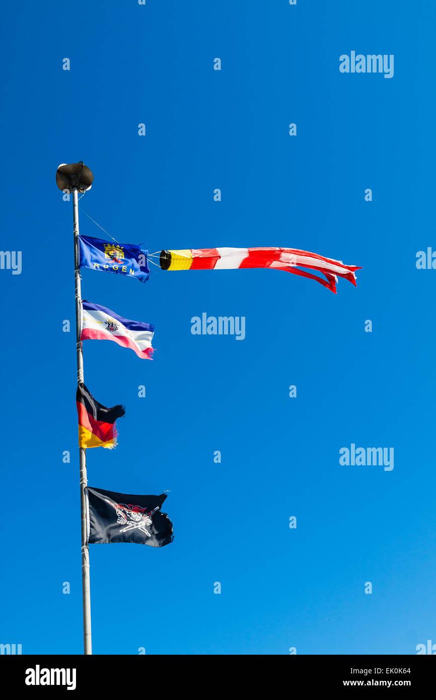 Flagpole and blue sky - Stock Image