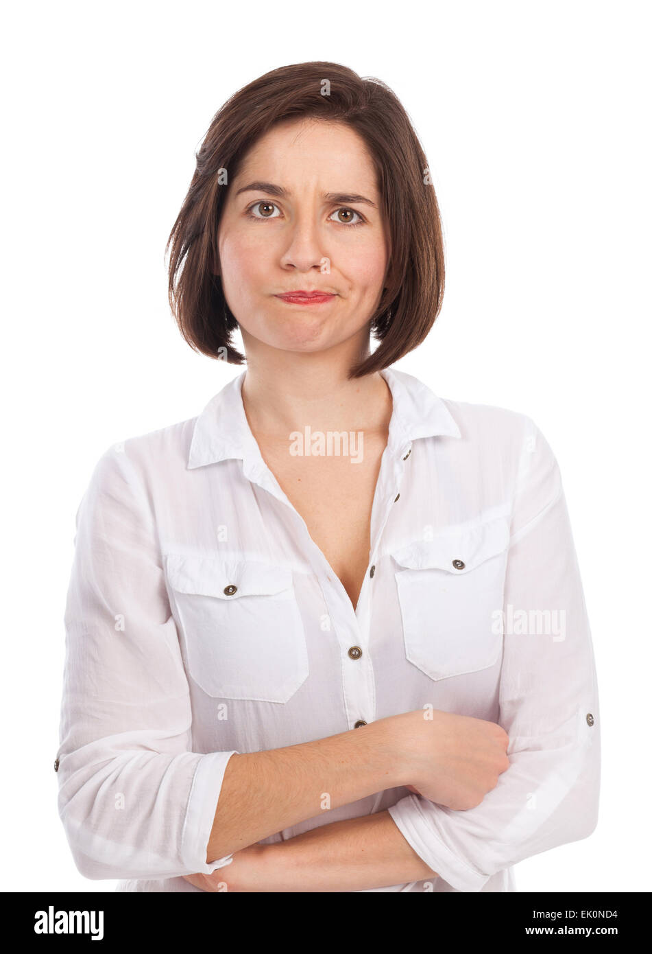 Portrait of a young woman looking discontented, wondering, indecisive, isolated on white - Stock Image
