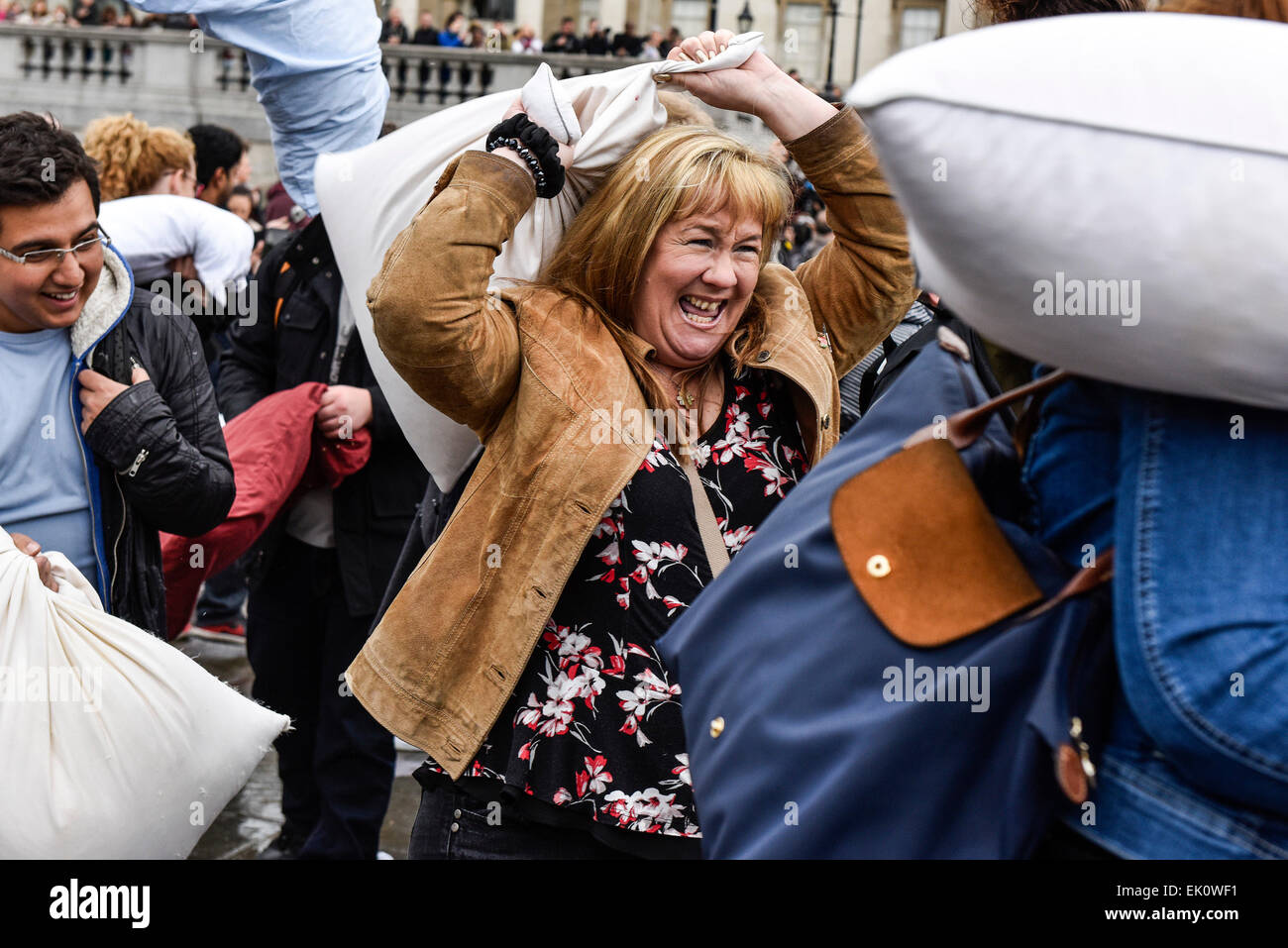 London, UK. 4th April, 2015. In Trafalgar Square thousands of pillow fighters battered each other until the feathers - Stock Image