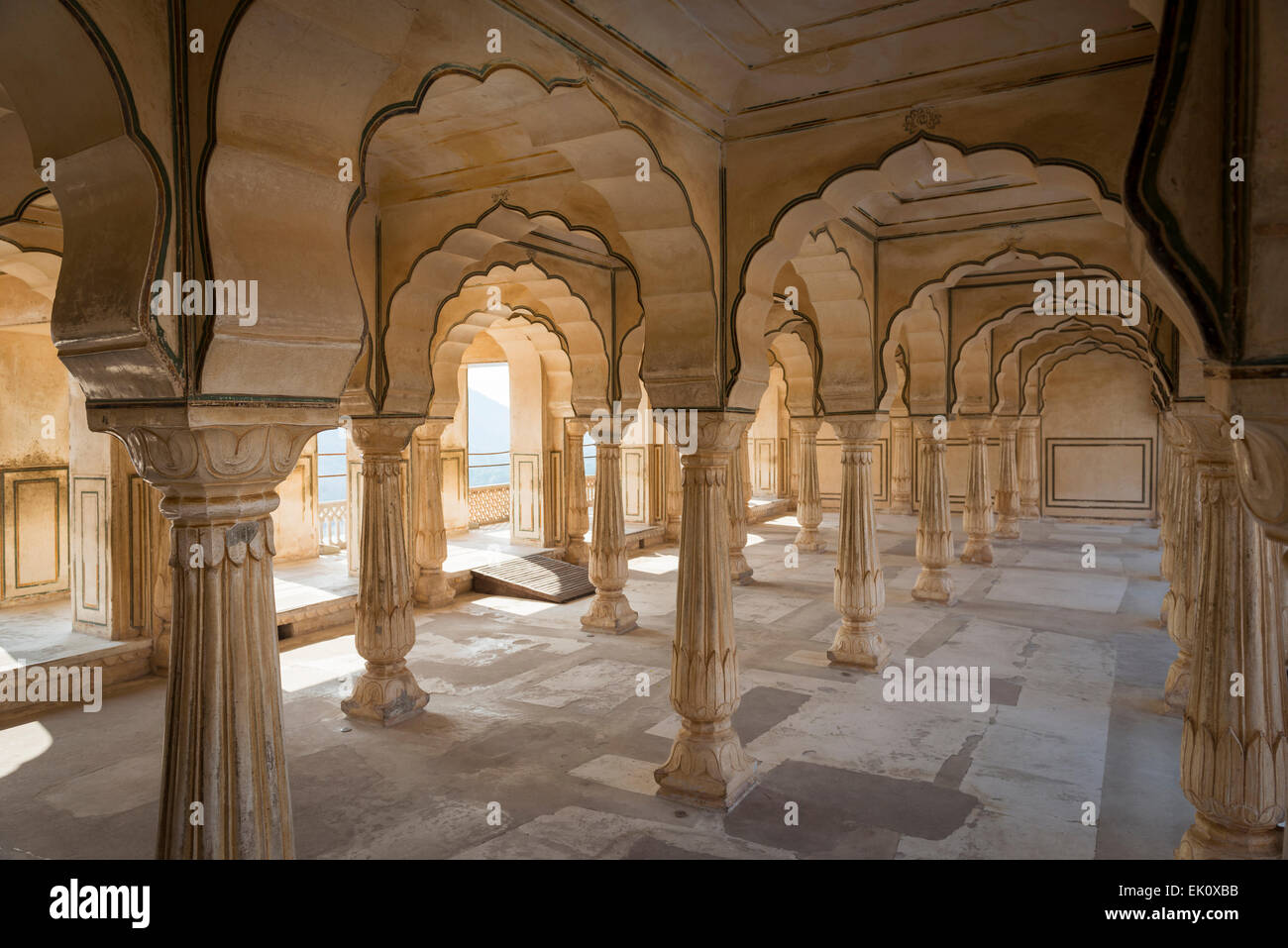 A colonnaded space in Amber Fort Palace near Jaipur, Rajasthan, India - Stock Image
